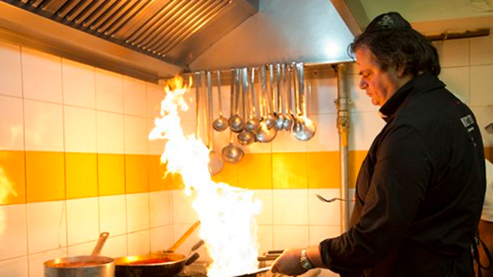Ba'Ghetto restaurant co-owner and chef Ilan Dabush cooks.