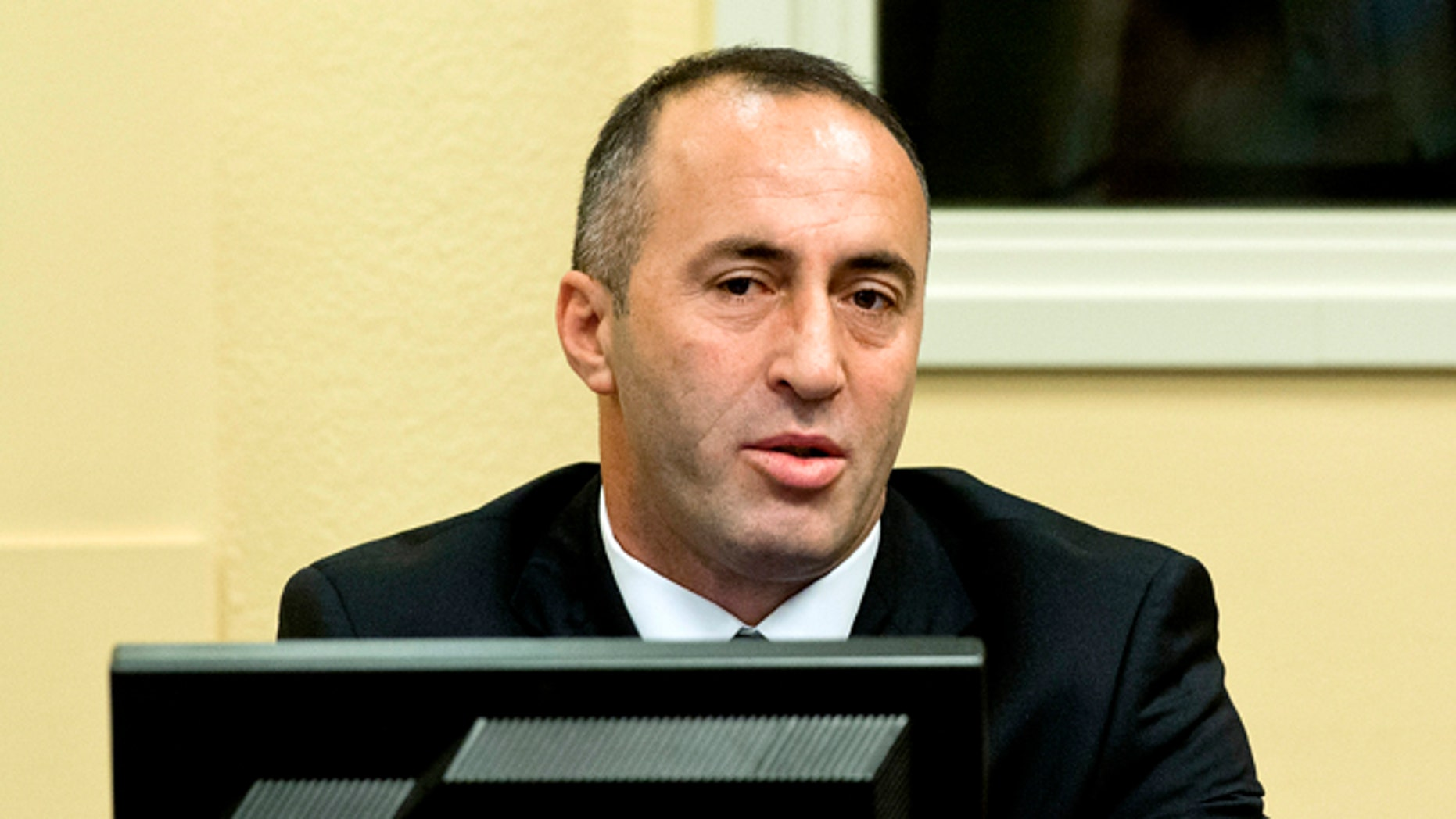Nov. 29, 2012: Former Kosovo Prime Minister Ramush Haradinaj awaits his verdict at the courtroom of the Yugoslav war crimes tribunal in The Hague, Netherlands.