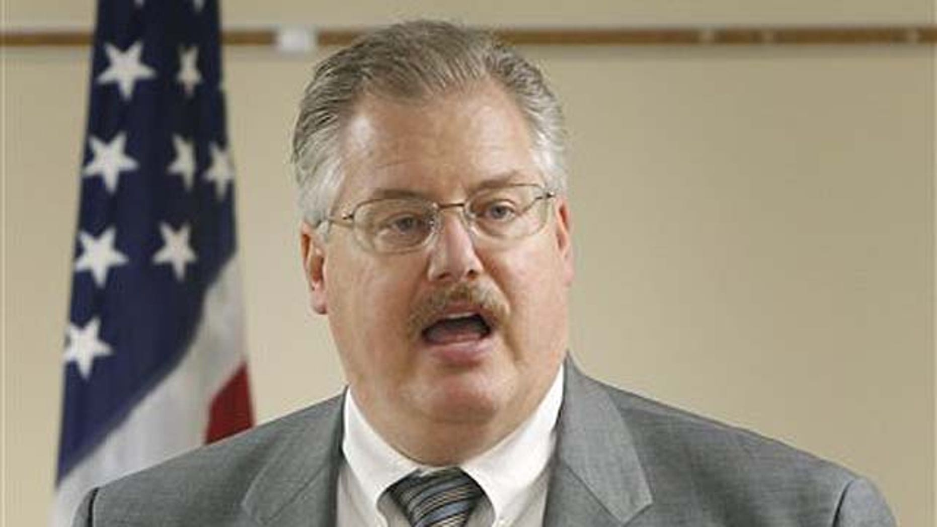 """Sept. 17:  Calumet County Dist. Atty. Ken Kratz, reads from a prepared statement, announcing that he will not be stepping down from his position during a news conference at the Calumet County Courthouse in Chilton, Wis. Kratz has shown in the two days since acknowledging he sent 30 text messages in three days to the 26-year-old woman last October. In one, he asked whether she was """"the kind of girl that likes secret contact with an older married elected DA."""""""