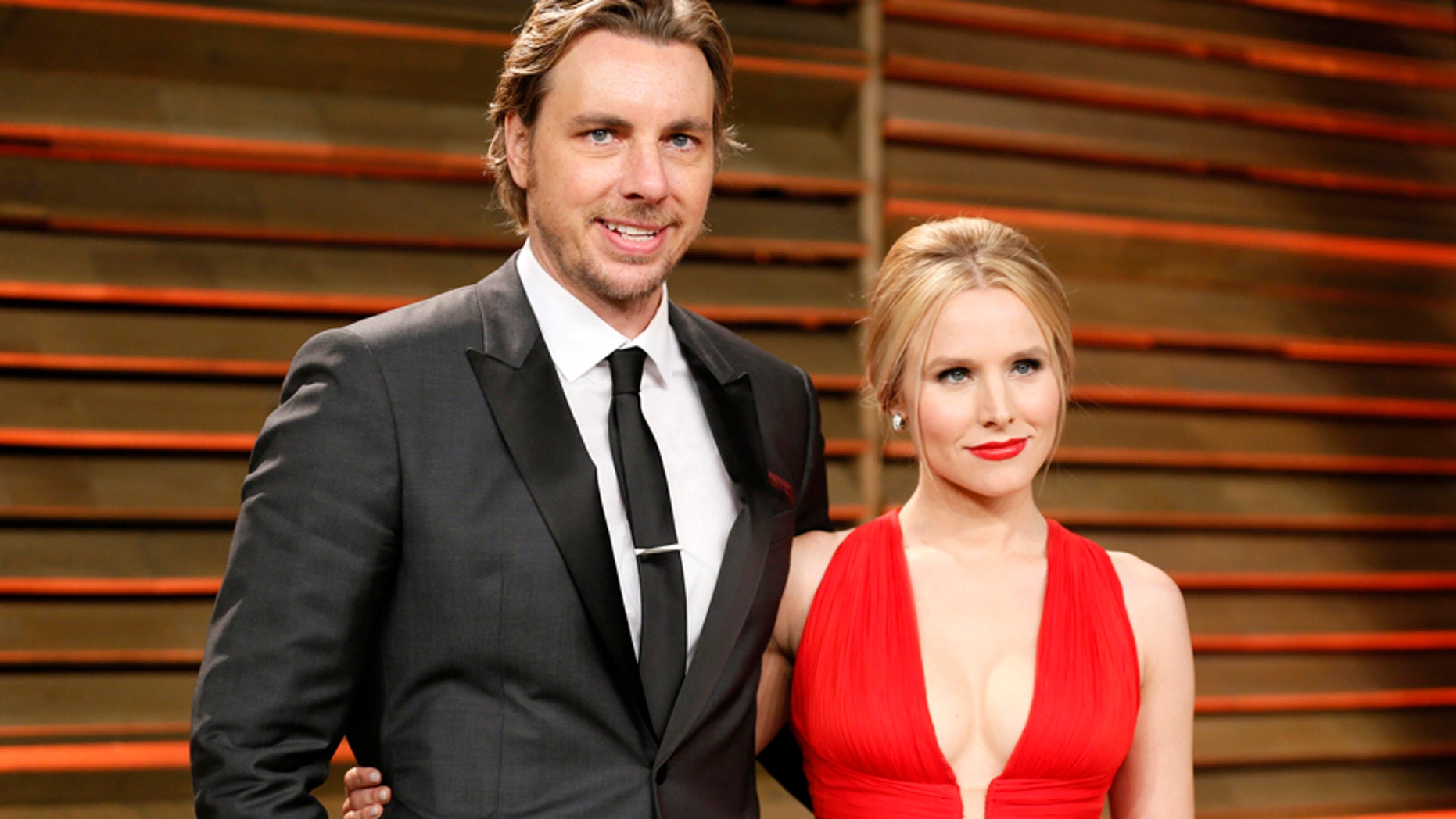 "Actress Kristen Bell and her husband, actor Dax Shepard, slam ""offensive"" tabloid story about their ""kinky"" sex life."