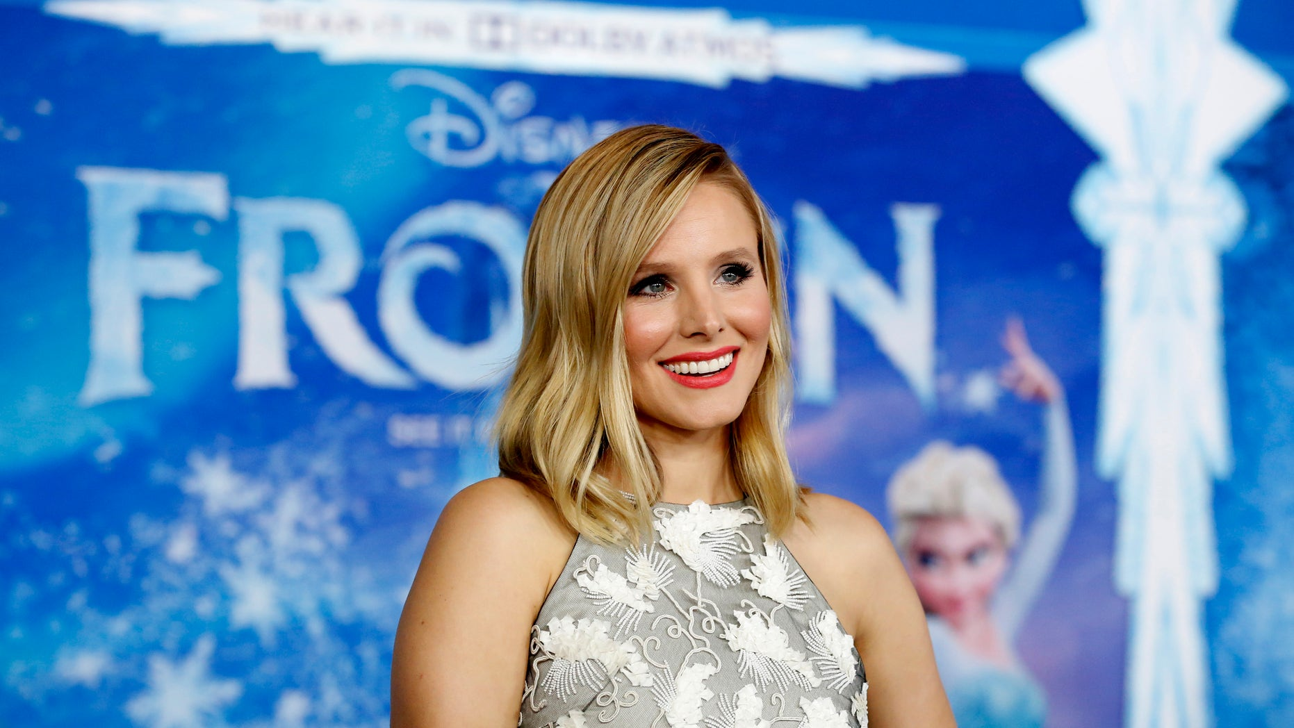 """Cast member Kristen Bell poses at the premiere of """"Frozen"""" at El Capitan theatre in Hollywood, California November 19, 2013."""