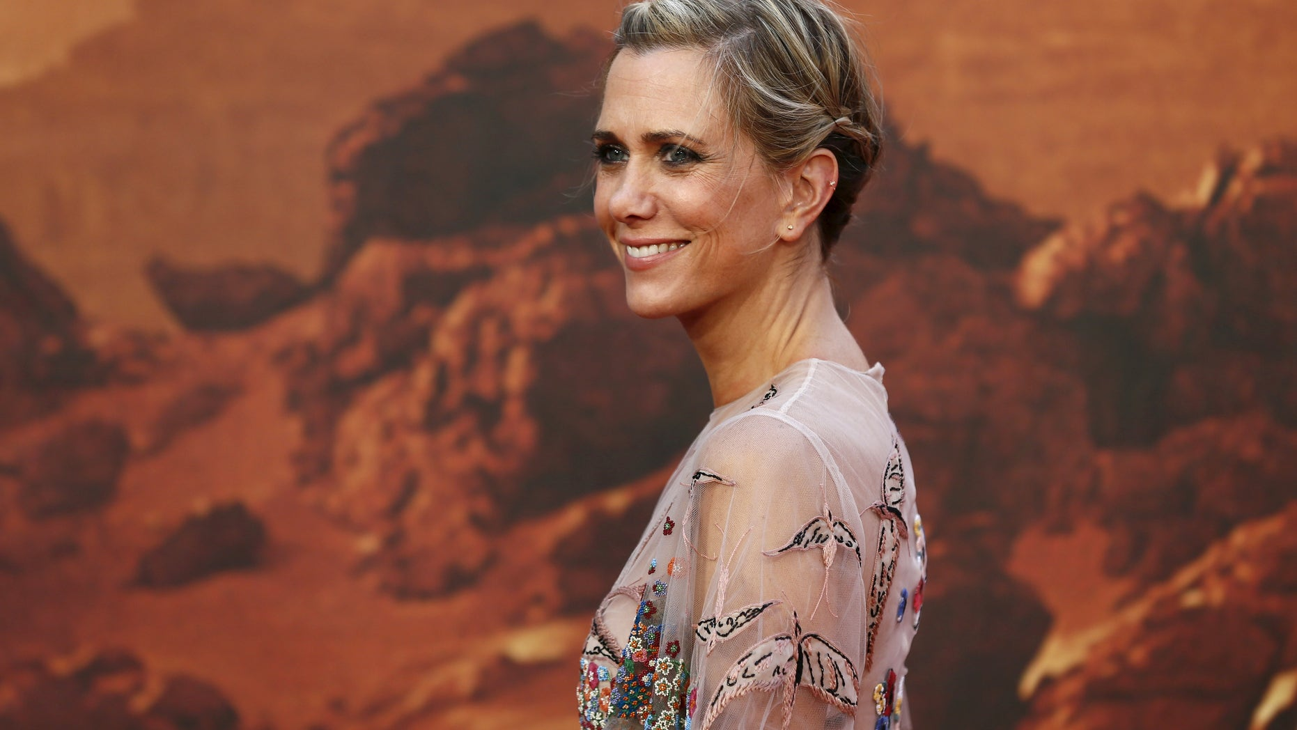"""Actress Kristen Wiig arrives for the UK premiere of """"The Martian"""" at Leicester Square in London, Britain, September 24, 2015. REUTERS/Stefan Wermuth - RTX1SBEZ"""