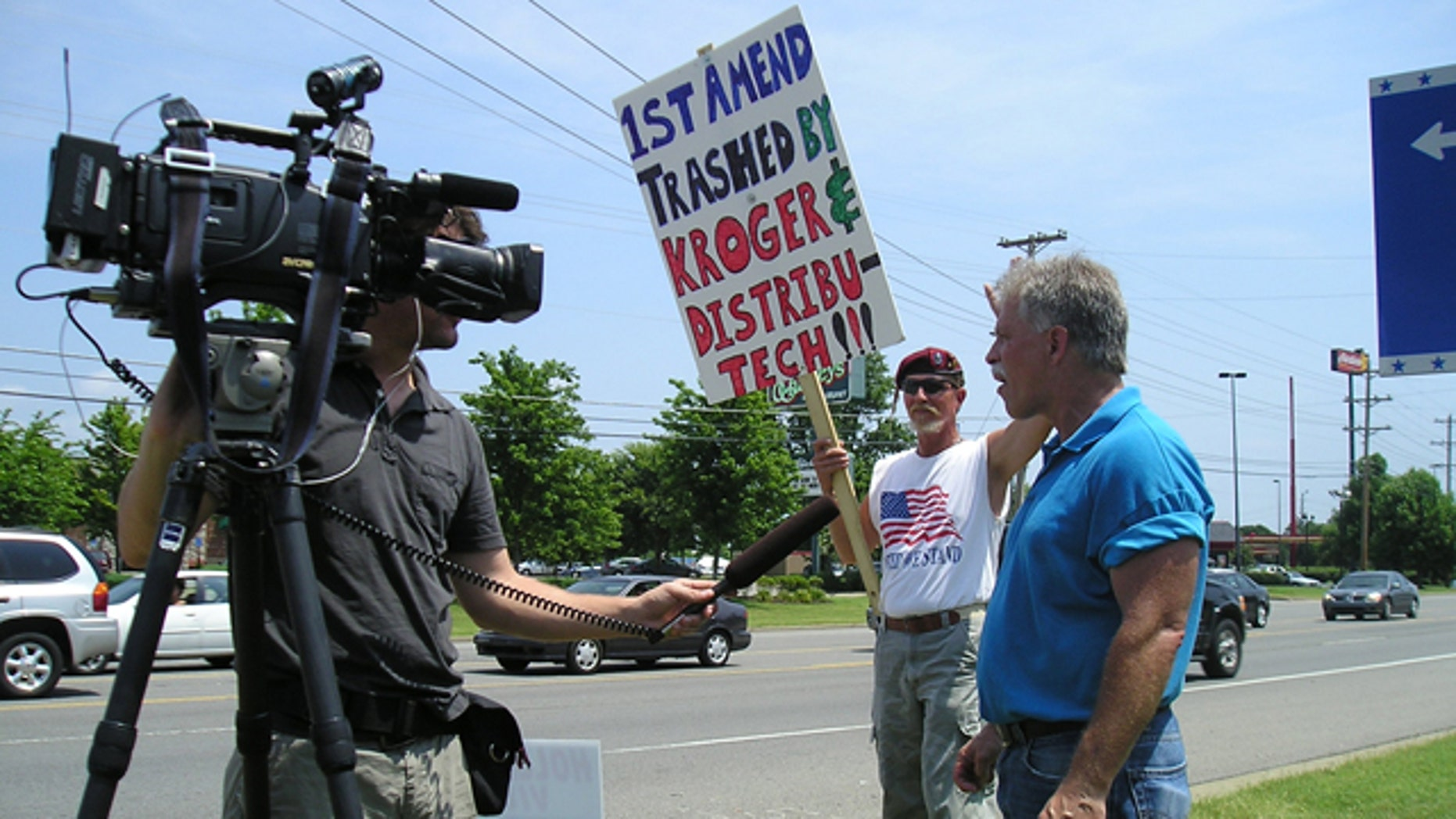 June 26, 2010: Protesters gather outside one of nine Kroger grocery stores that banned The Rutherford Reader.