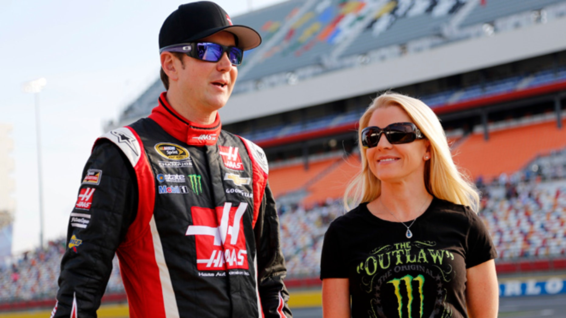 In this May 22, 2014, file photo, Kurt Busch, left, stands with Patricia Driscoll before qualifying for a NASCAR Sprint Cup series auto race at Charlotte Motor Speedway in Concord, N.C.