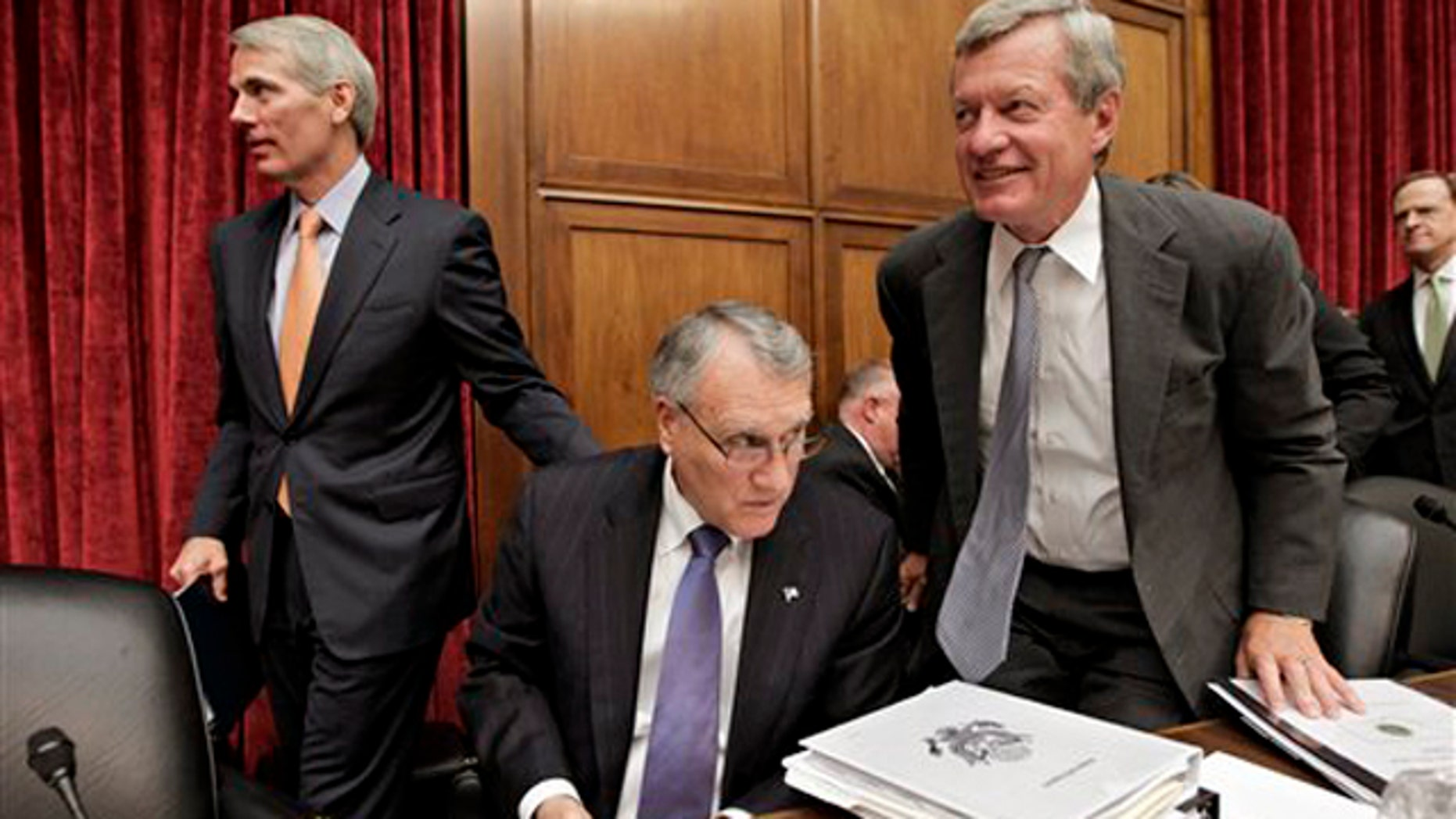 Sen. Jon Kyl, center, Sen. Max Baucus, right, and Sen. Rob Portman, left, finish with a meeting of the Joint Select Committee on Deficit Reduction on Capitol Hill in Washington Sept. 8.