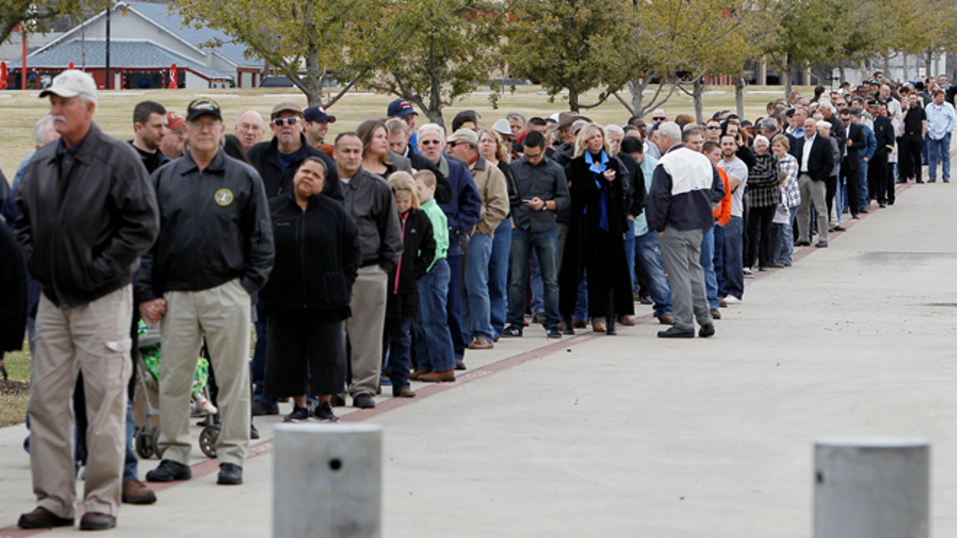 Feb. 11, 2013: People wait in line to attend a memorial service for Christopher Kyle at Cowboys Stadium in Arlington, Texas.