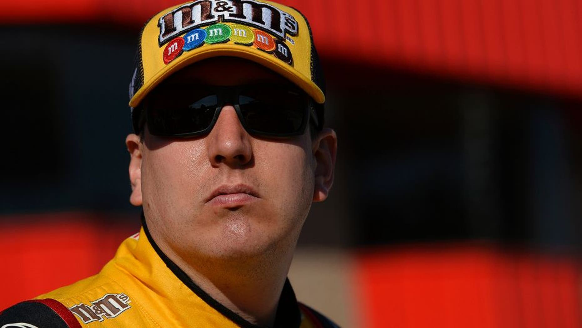 FONTANA, CA - MARCH 18: Kyle Busch, driver of the #18 M&M's 75 Toyota, stands on the grid during qualifying for the NASCAR Sprint Cup Series Auto Club 400 at Auto Club Speedway on March 18, 2016 in Fontana, California. (Photo by Robert Laberge/Getty Images)