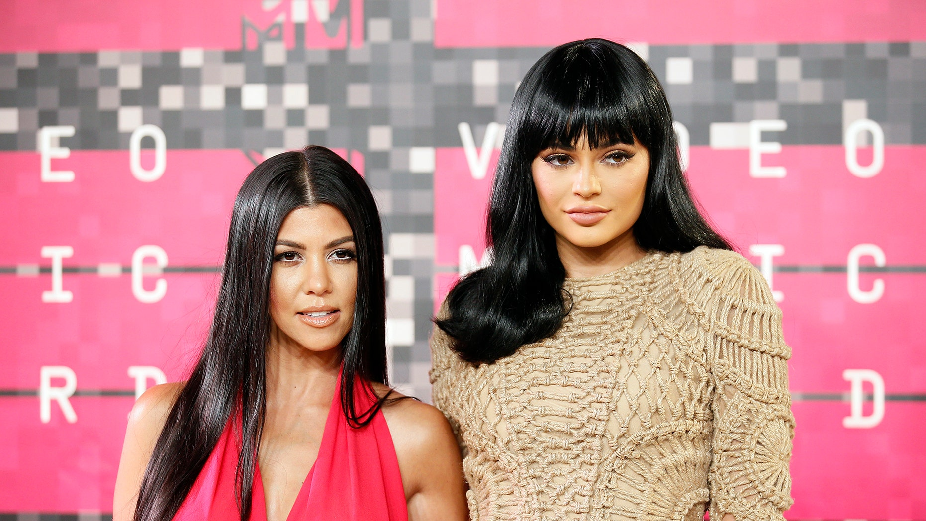 Reality television stars Kourtney Kardashian and Kylie Jenner arrive at the 2015 MTV Video Music Awards in Los Angeles, California, August 30, 2015.
