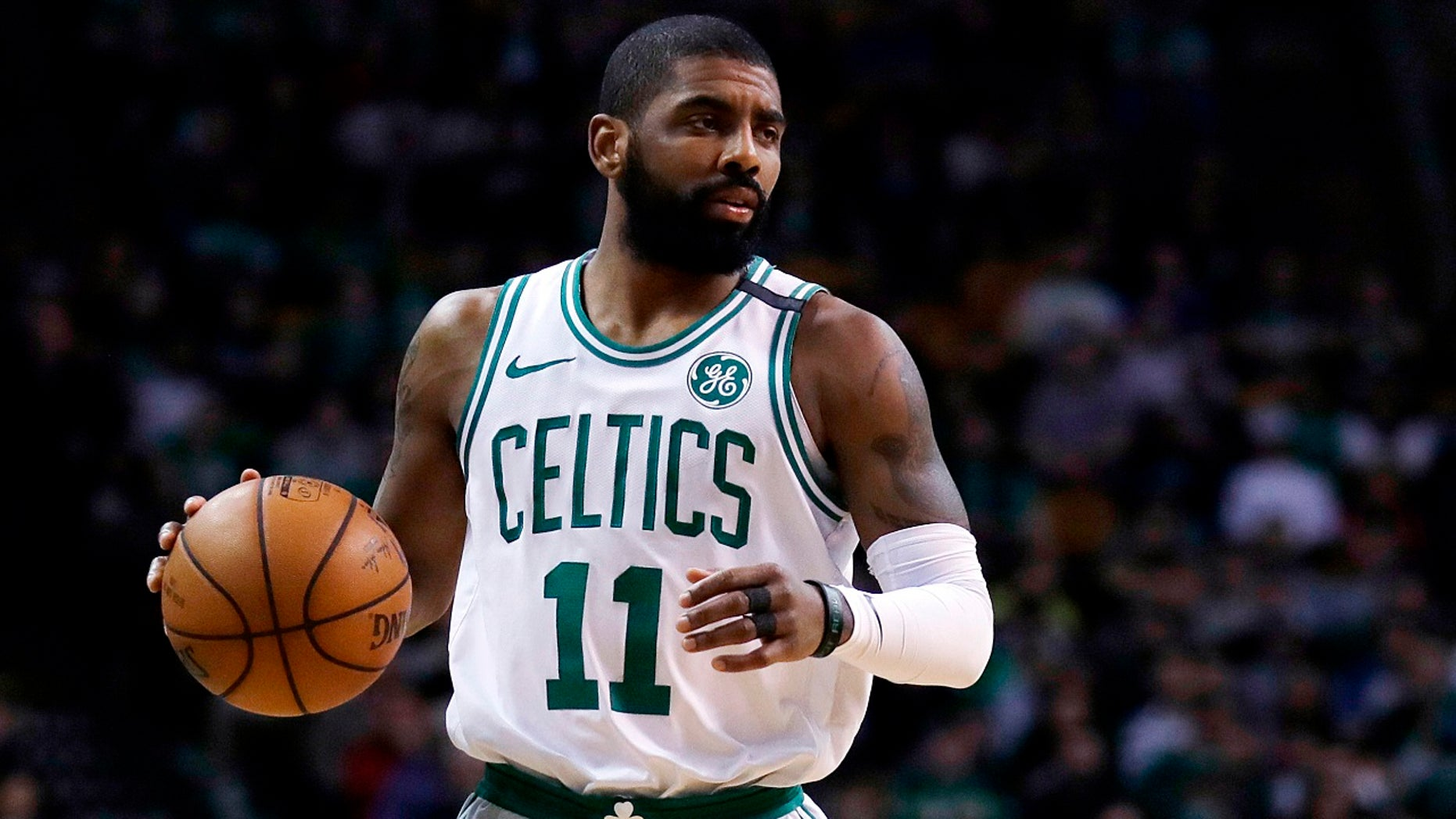 Boston Celtics guard Kyrie Irving (11) moves down court during the first quarter of an NBA basketball game in Boston, Feb 28, 2018.