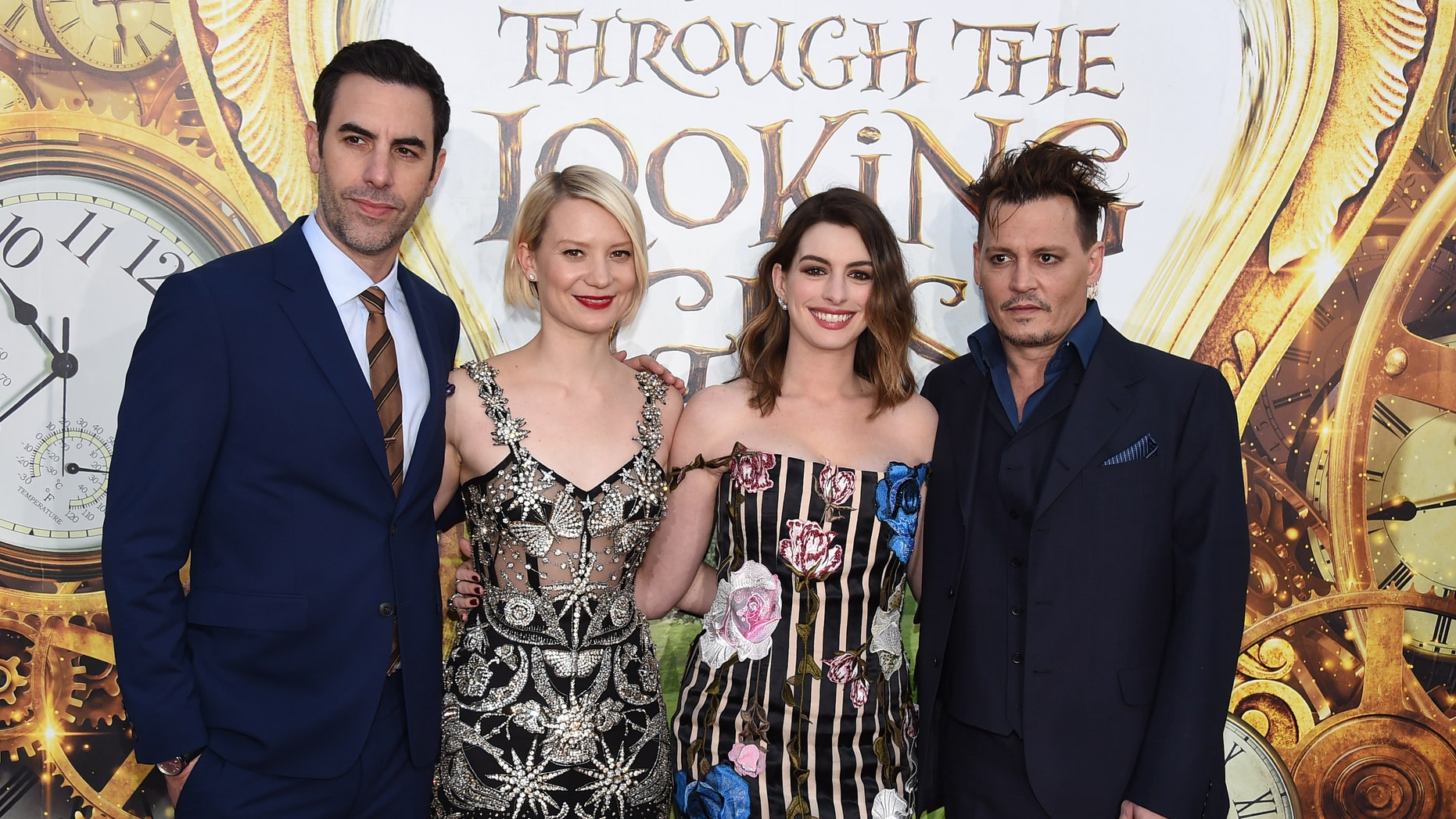"""Sacha Baron Cohen, Mia Wasikowska, Anne Hathaway and Johnny Depp at the Los Angeles premiere of """"Alice Through the Looking Glass."""""""