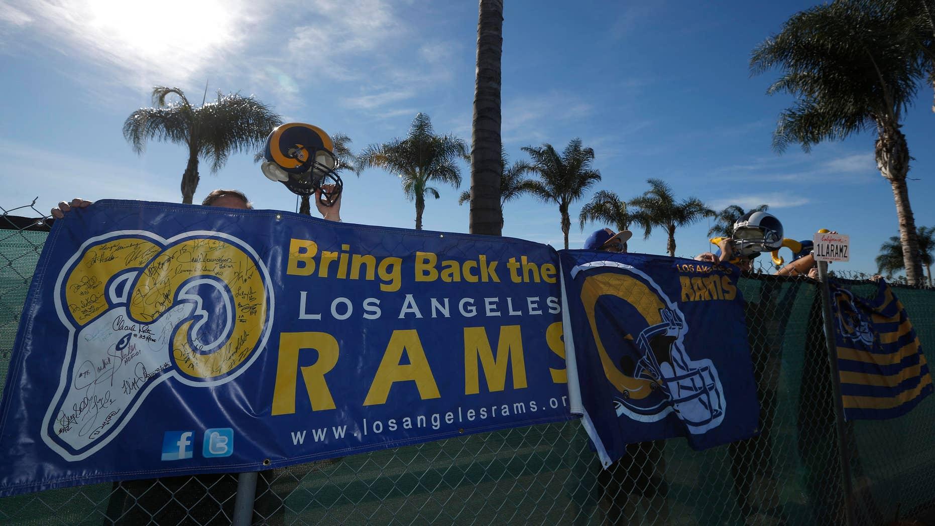 Jan. 5, 2015: NFL fans Tom Bateman (L-R), 43, Skye Sverdlin, 36, Daniel Balma, 36, and Joe Ramirez, 54, show their support for the St. Louis Rams NFL team to come to Los Angeles.