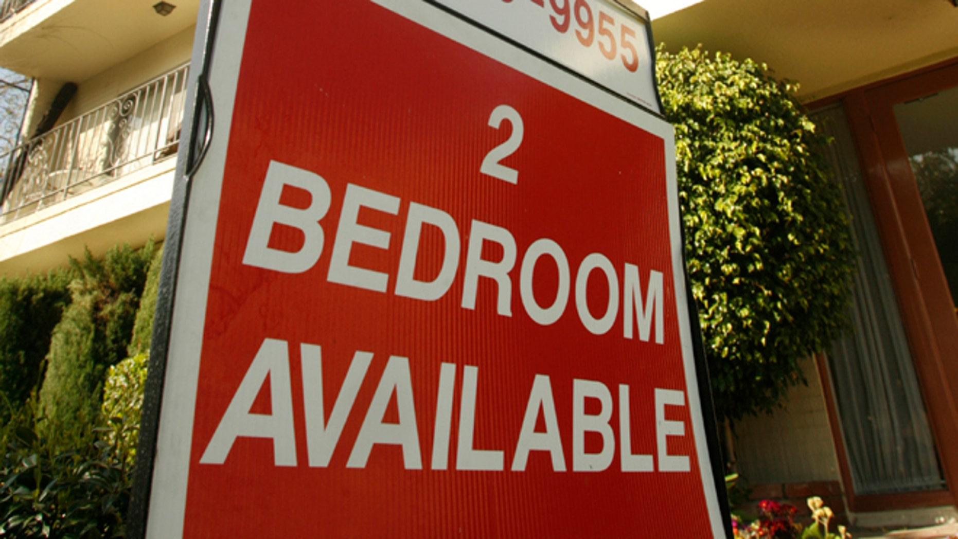 This file photo shows a sign at an apartment building in Los Angeles.