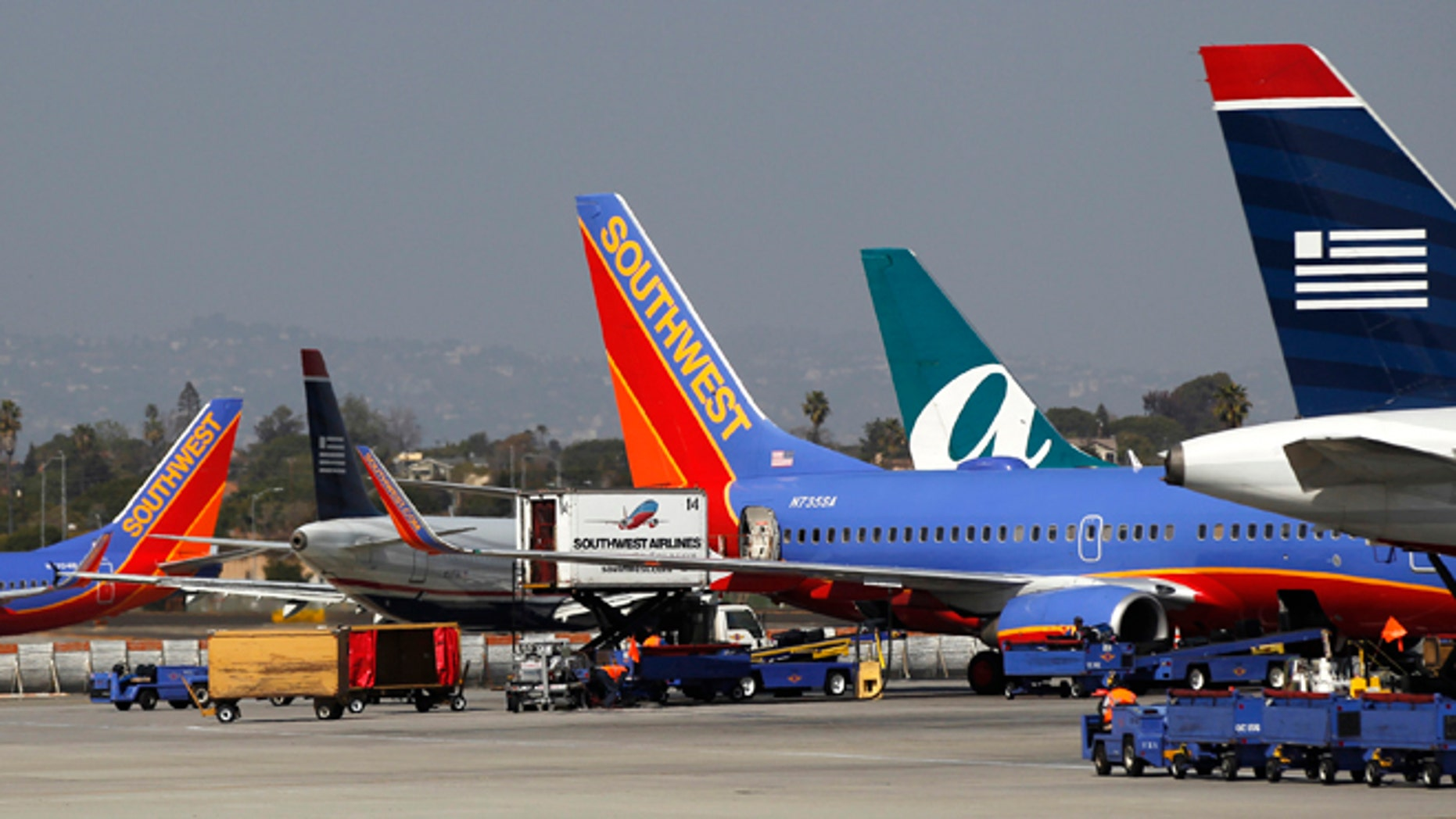FILE: Airplanes are seen parked at Los Angeles International Airport last March.