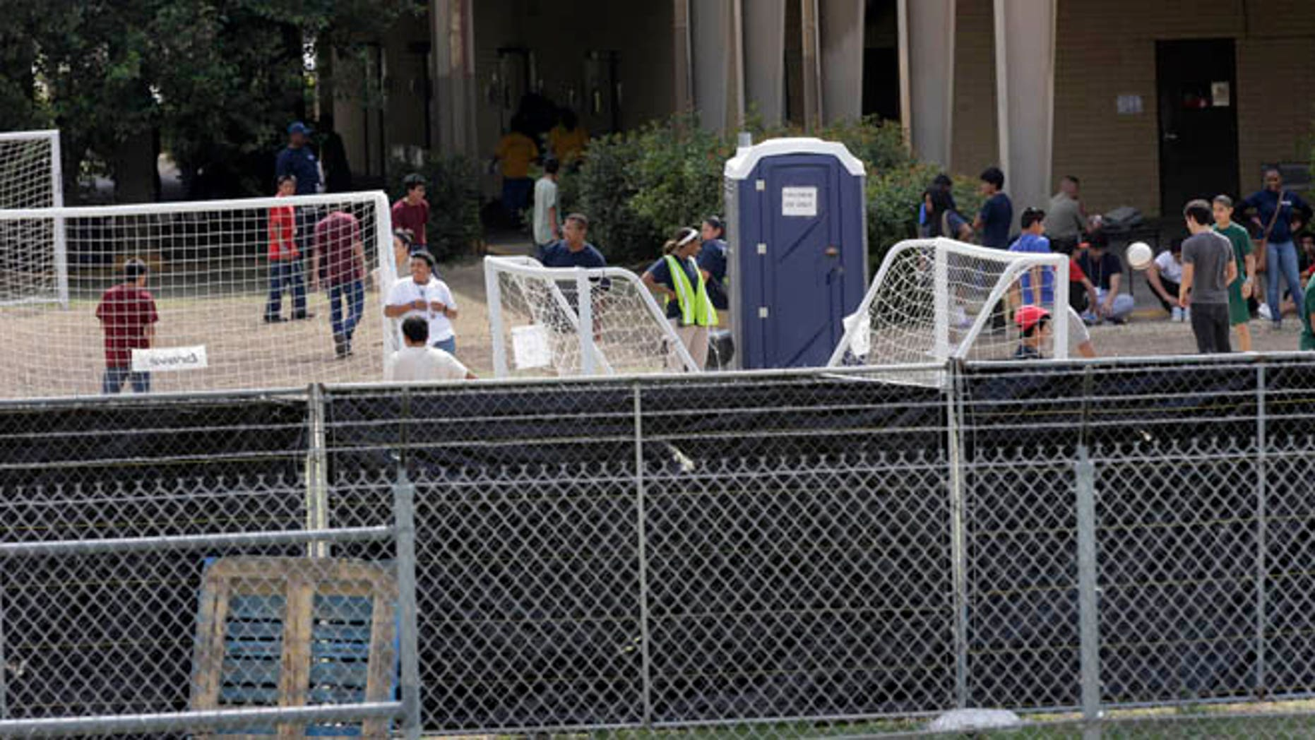 June 23, 2014: A temporary shelter for unaccompanied minors who have entered the country illegally is seen at Lackland Air Force Base in San Antonio, Texas.
