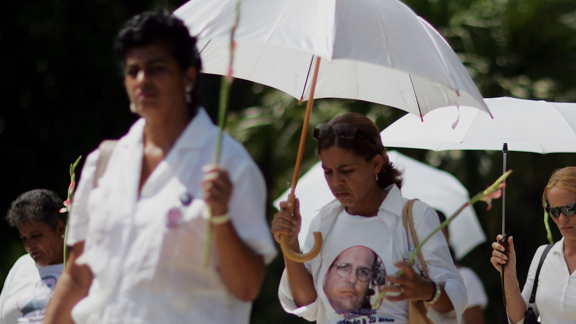 HAVANA - SEPTEMBER 17: Members of the Women in White movement of wives and mothers of imprisoned dissidents march together September 17, 2006 in Havana, Cuba. The Women in White began in 2004 after dissidents were arrested and jailed in the crackdown in 2003. The island nation still waits for the first appearance of President Fidel Castro among the general public after he turned over power to his brother, Raul Castro, following surgery in July.  (Photo by Joe Raedle/Getty Images)