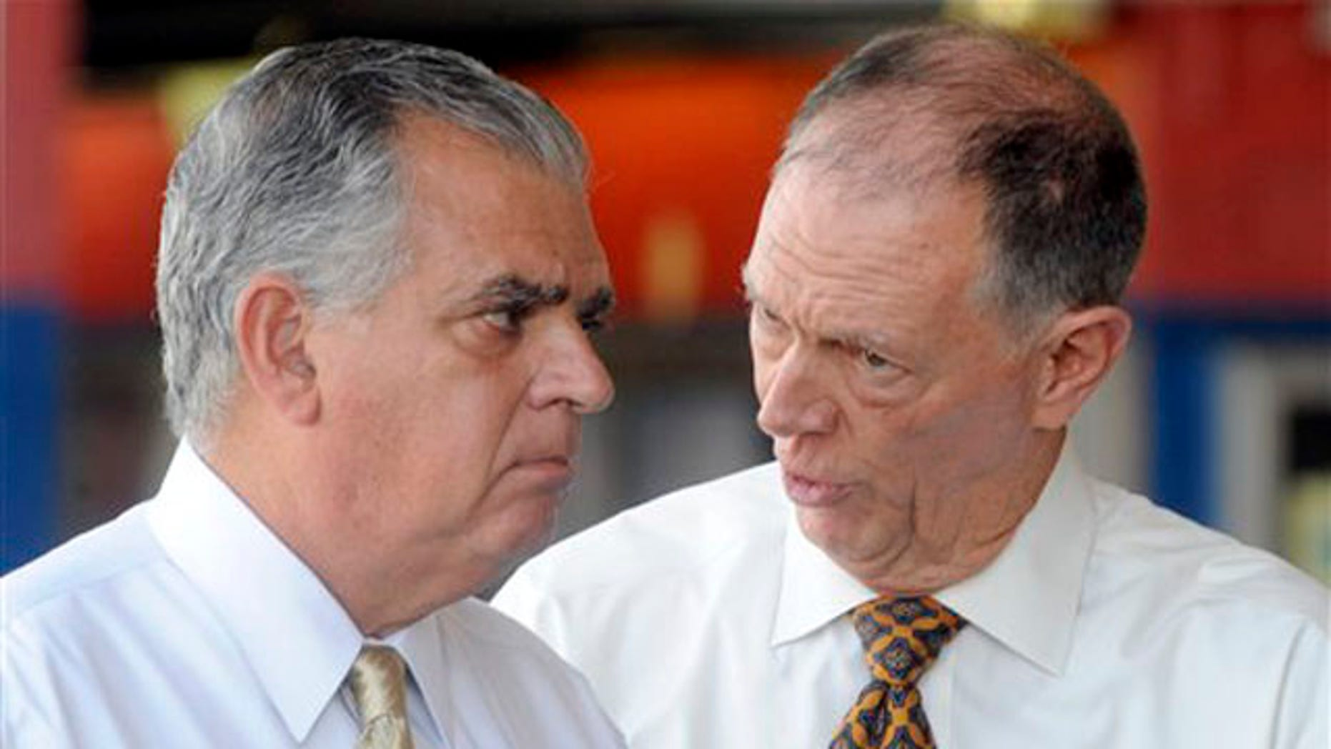 Transportation Secretary Ray LaHood, left, talks to FAA Administrator Randy Babbitt during a news conference to discuss the interruption of FAA funding in New York Aug. 1.