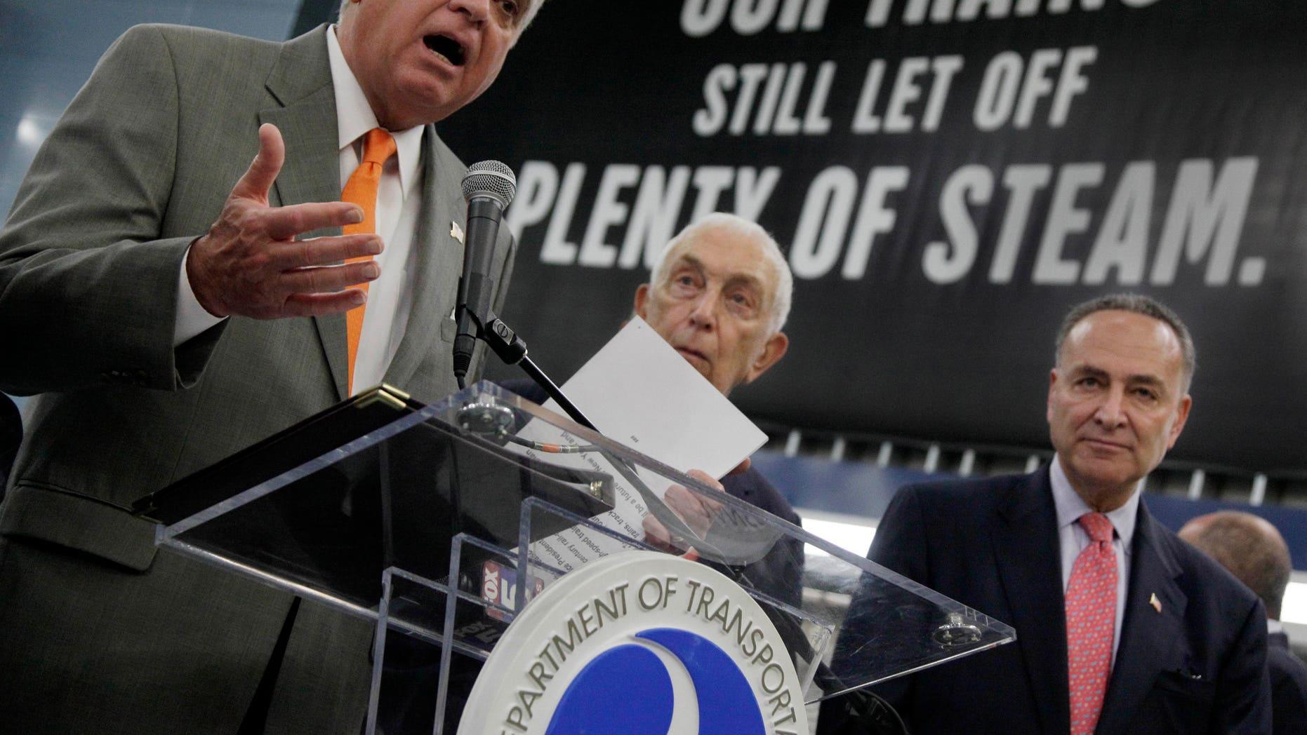 Monday: Sen. Charles Schumer, right, and Sen. Frank Lautenberg look on as U.S. Transportation Secretary Ray LaHood announces new rail funding at New York' Pennsylvania Station.