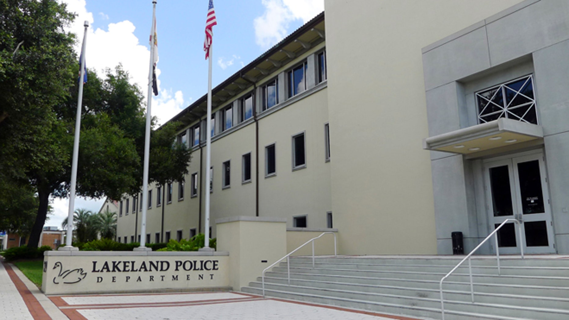 July 9, 2013: The exterior of the Lakeland Police Department building is shown in downtown Lakeland, Fla. Nearly a dozen police officers in Lakeland are under investigation after state and local officials uncovered a widespread sex scandal that has unfolded over eight years. A civilian crime analyst for the department says she had consensual and sometimes coerced sex with the officers. (AP/Tamara Lush)