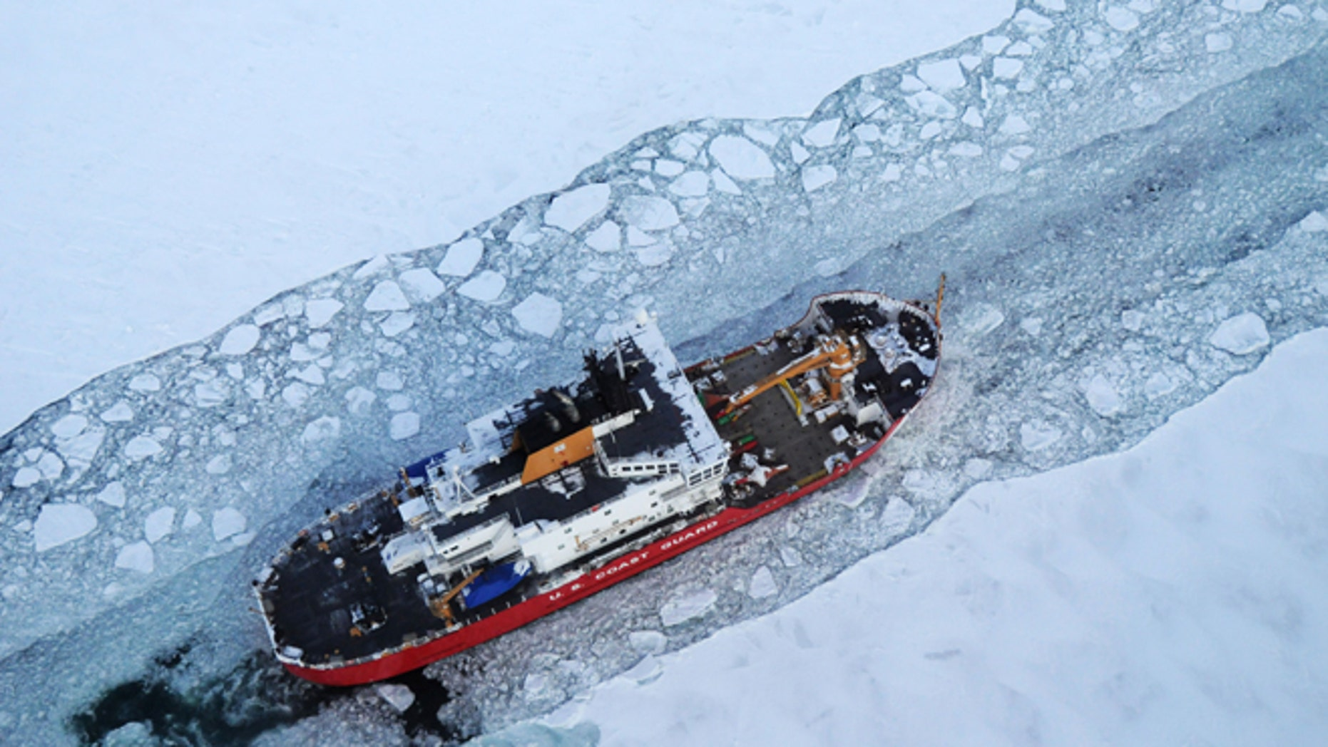 Dec. 26, 2013: In this photo provided by the U.S. Coast Guard the icebreaker Mackinaw maintains a shipping lane on the St. Marys River linking Lakes Superior and Huron.