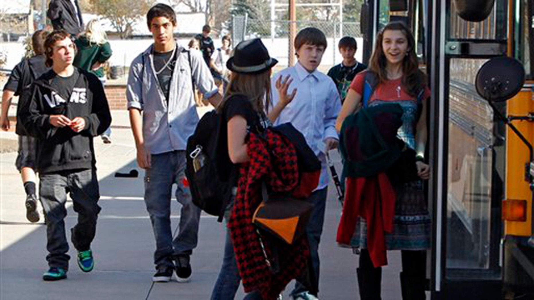 Oct. 28, 2011: Students at Carmody Middle School board buses after school in Lakewood, Colo. The only statewide tax vote on the ballot in the Nov. 2 election asked voters to pay more tax to support the school system.