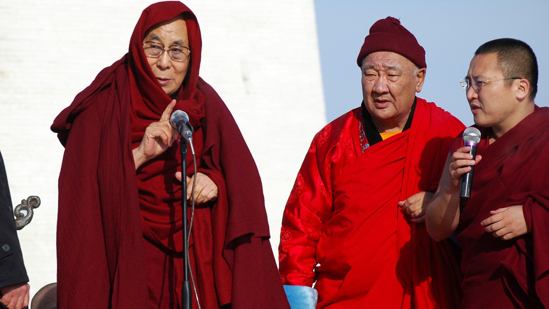 Nov. 19, 2016: The Dalai Lama, left, speaks at the Janraiseg Temple of Gandantegchinlen monastery in Ulaanbaatar, Mongolia.