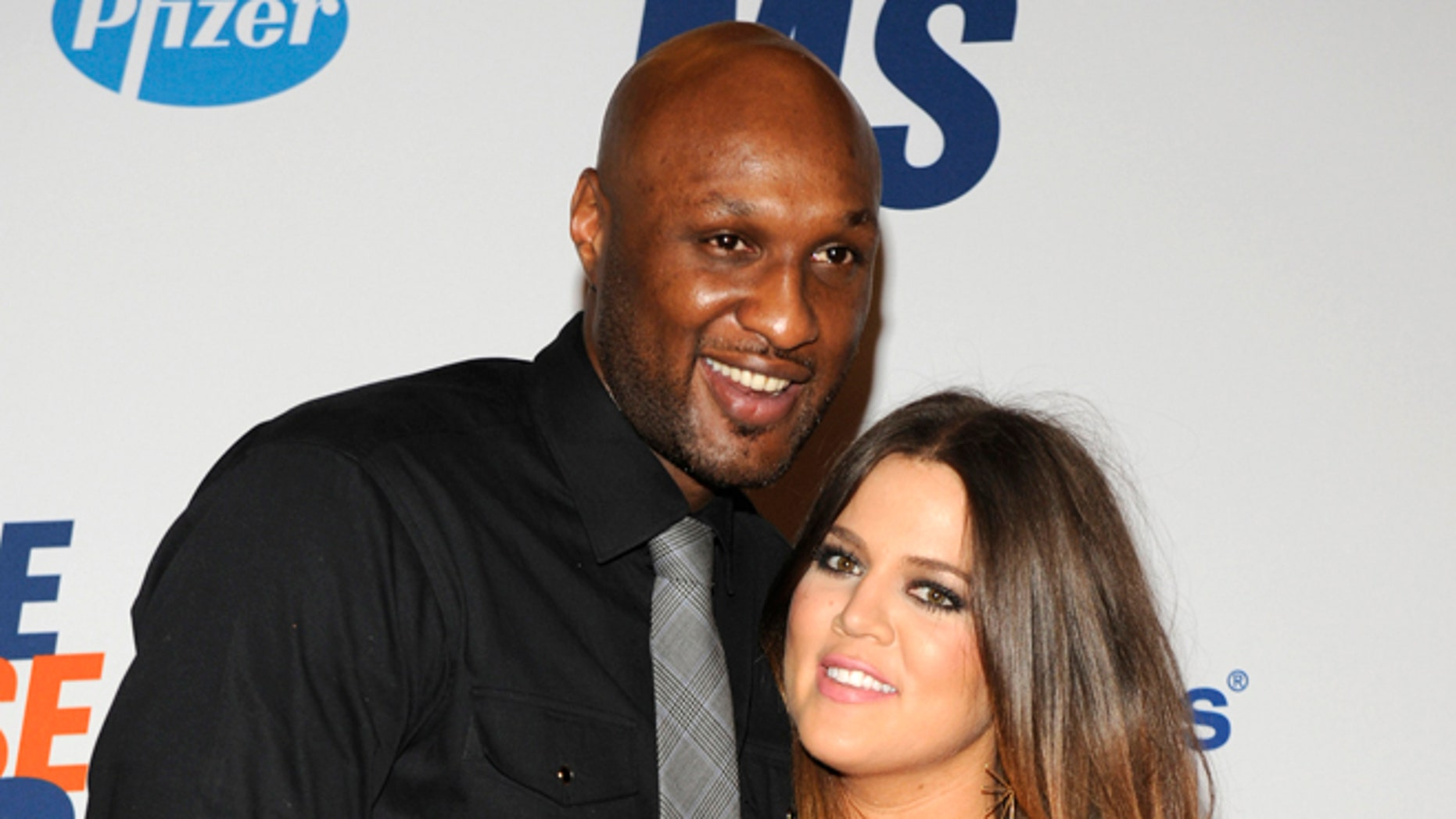 May 18, 2012. Lamar Odom (L), basketball player with the Dallas Mavericks of the NBA, and his wife Khloe Kardashian-Odom arrive for the 19th annual Race to Erase MS Gala in Los Angeles.