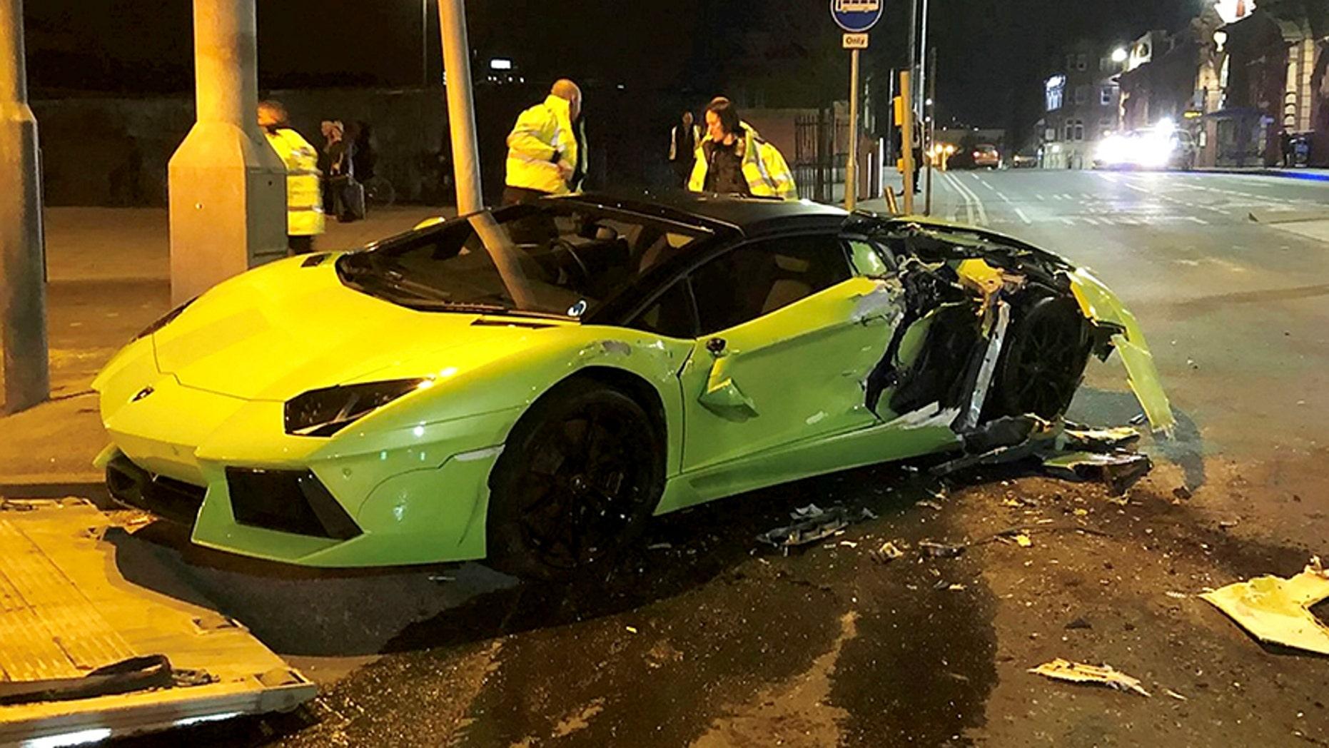 The Wreckage Of A Green Lamborghini Following Crash With Bus In Carrington Street