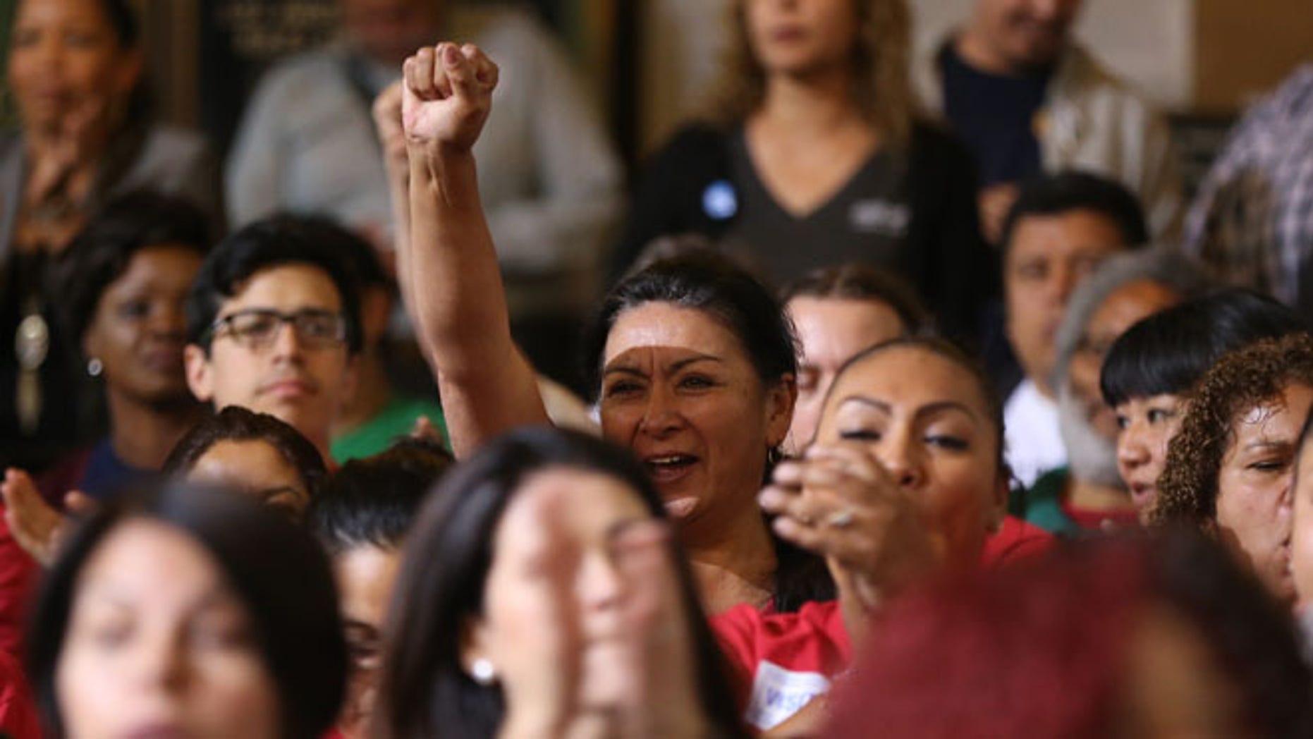 May 19, 2015: Workers react as the Los Angeles City Council votes to raise the minimum wage in the city to $15 an hour by 2020, making it the largest city in the nation to do so, in Los Angeles. (AP)