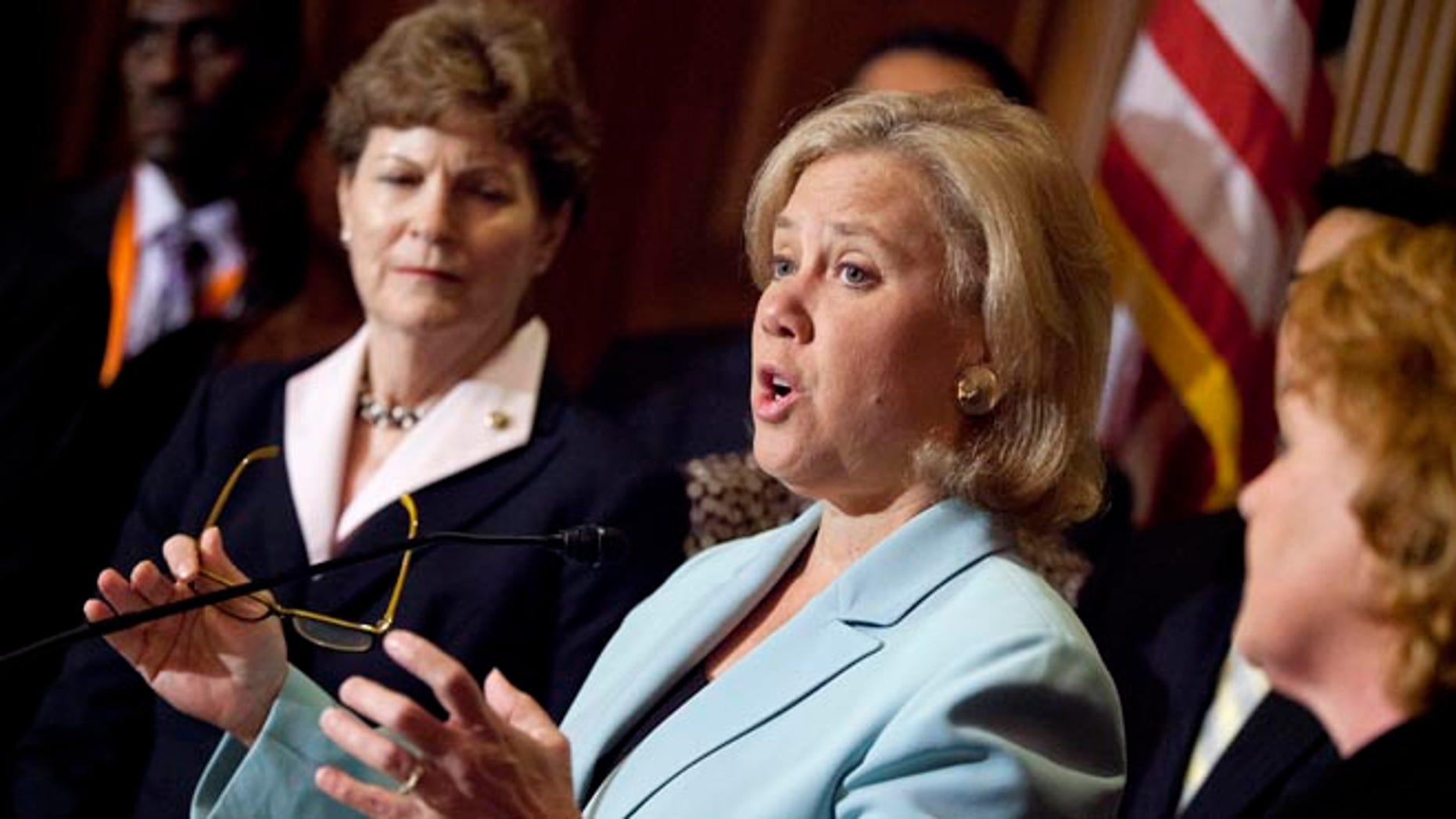 Oct. 3, 2013: Sen. Mary Landrieu, D-La., center, joined by Sen. Jeanne Shaheen, D-N.H., left, Sen. Heidi Heitkamp, D-N.D., right, she speaks during a news conference on Capitol Hill in Washington. (AP)