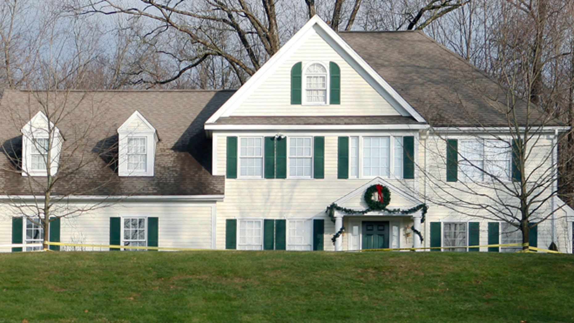 In this Dec. 18, 2012, file photo, crime scene tape surrounds the home of Nancy Lanza in Newtown, Conn.