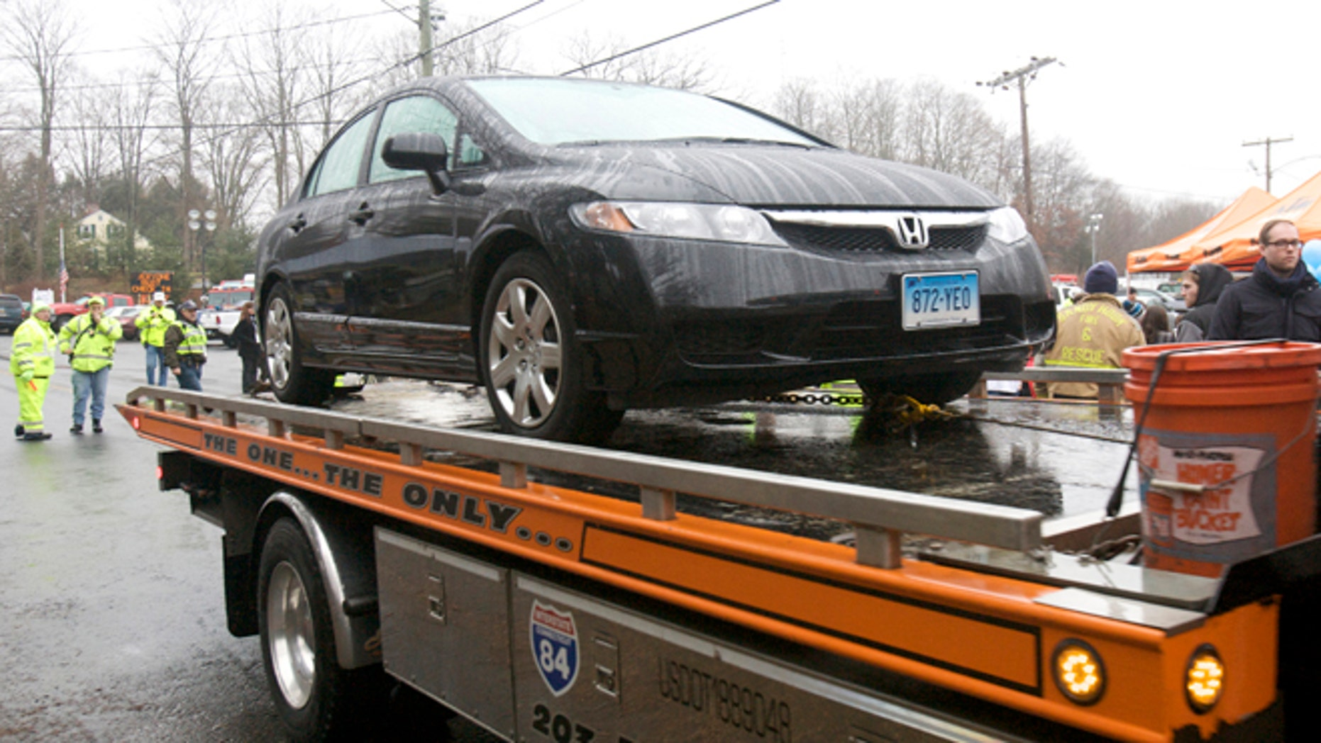 Dec. 16, 2012: The car driven by Connecticut school shooter Adam Lanza is towed from Sandy Hook Elementary School in Newtown, Conn.