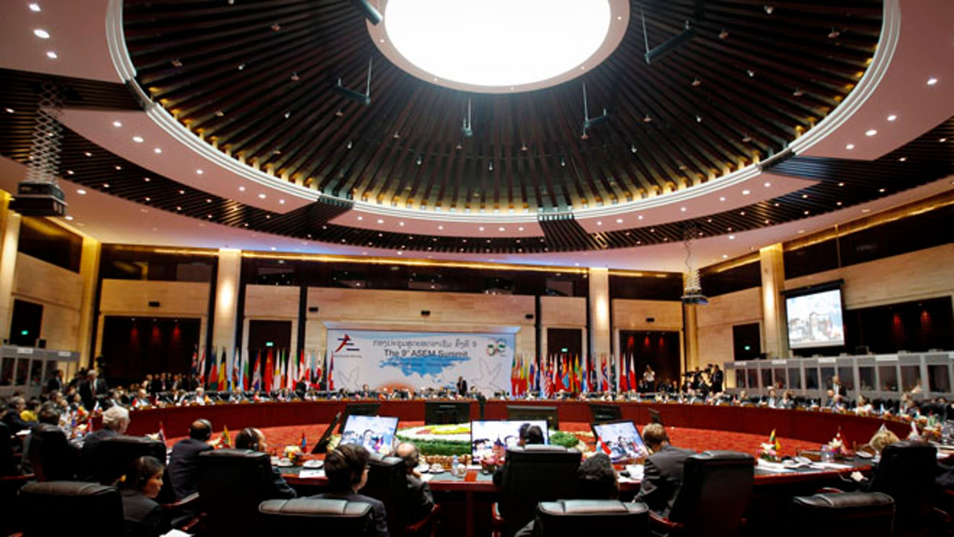 Nov. 6, 2012: European and Asian leaders take part in the closing ceremony for the ASEM Summit in Vientiane, Laos.