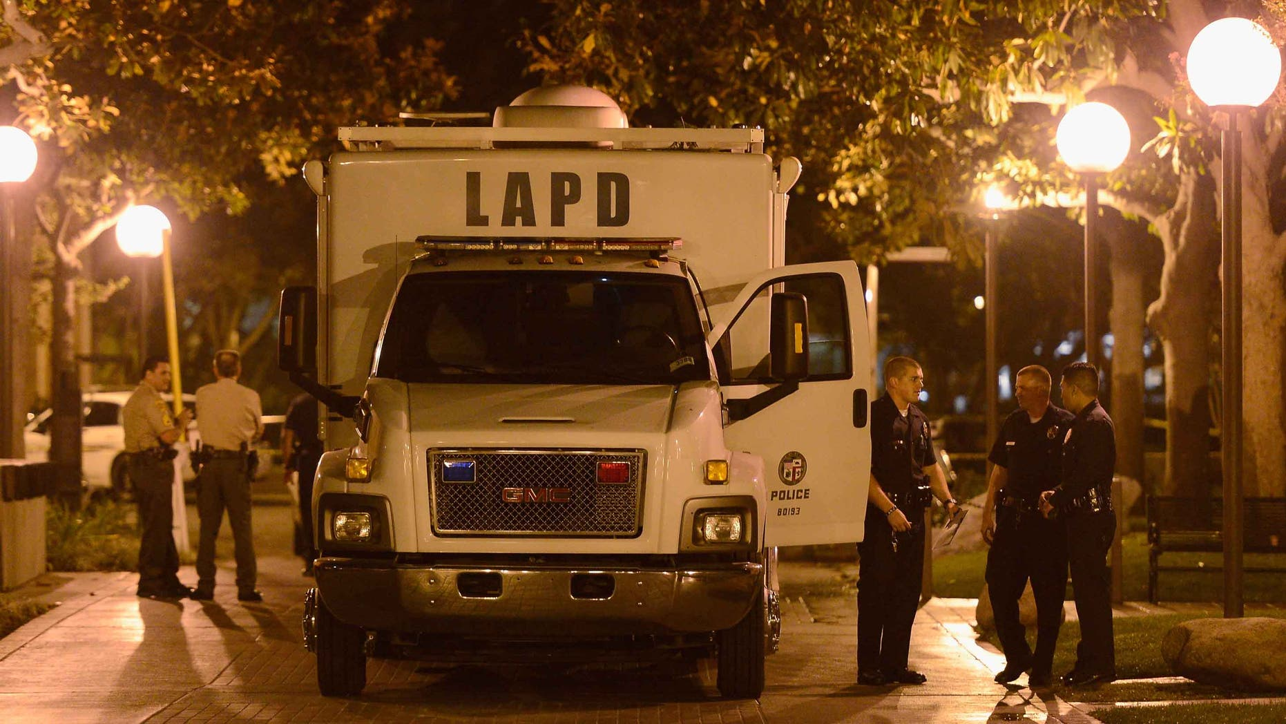 LOS ANGELES, CA - NOVEMBER 01:  Los Angeles Police Department officers and USC Department of Public Safety officer gather at the command post after four people were shot including one in critical condition during a Halloween party at the Tutor Campus Center on November 1, 2012 in Los Angeles, California. The university issued an alert to students and staff that the police were investigating an incident and requested the campus be shut down while encouraging others to stay away from the area to further notice.  (Photo by Kevork Djansezian/Getty Images)