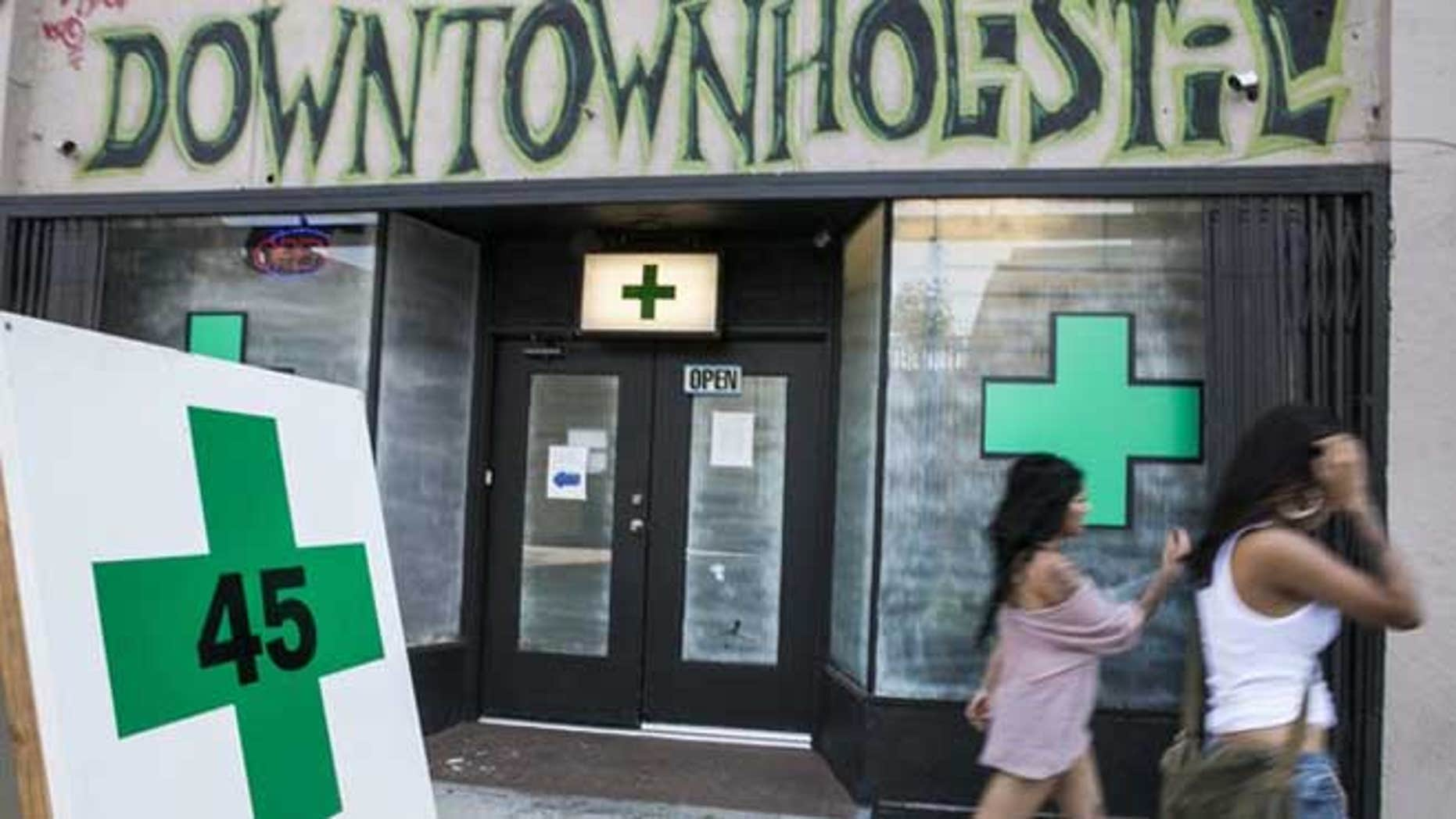 July 24, 2012: Pedestrians walk past a medical marijuana dispensary in the Echo Park area of Los Angeles.