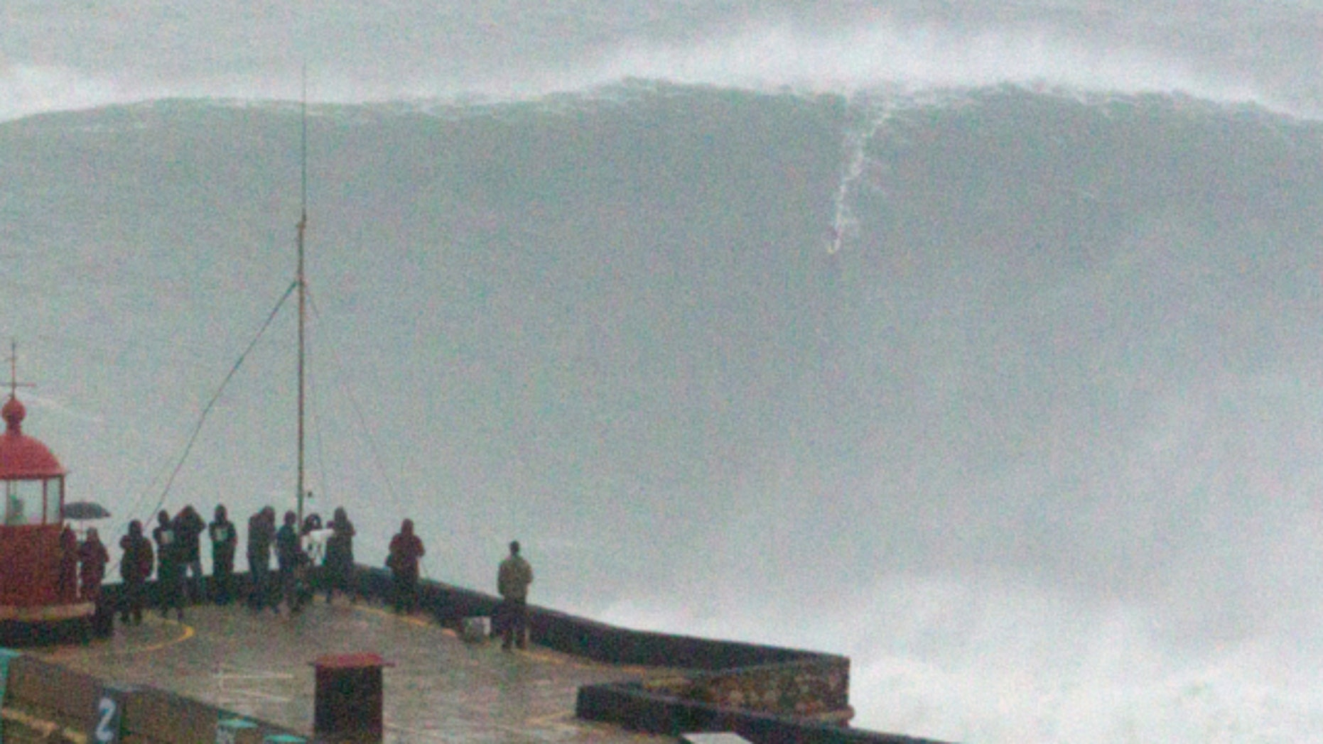 Oct. 28 2013: Brazilian surfer Carlos Burle rides a big wave at the Praia do Norte, north beach, at the fishing village of Nazare in Portugal's Atlantic coast.