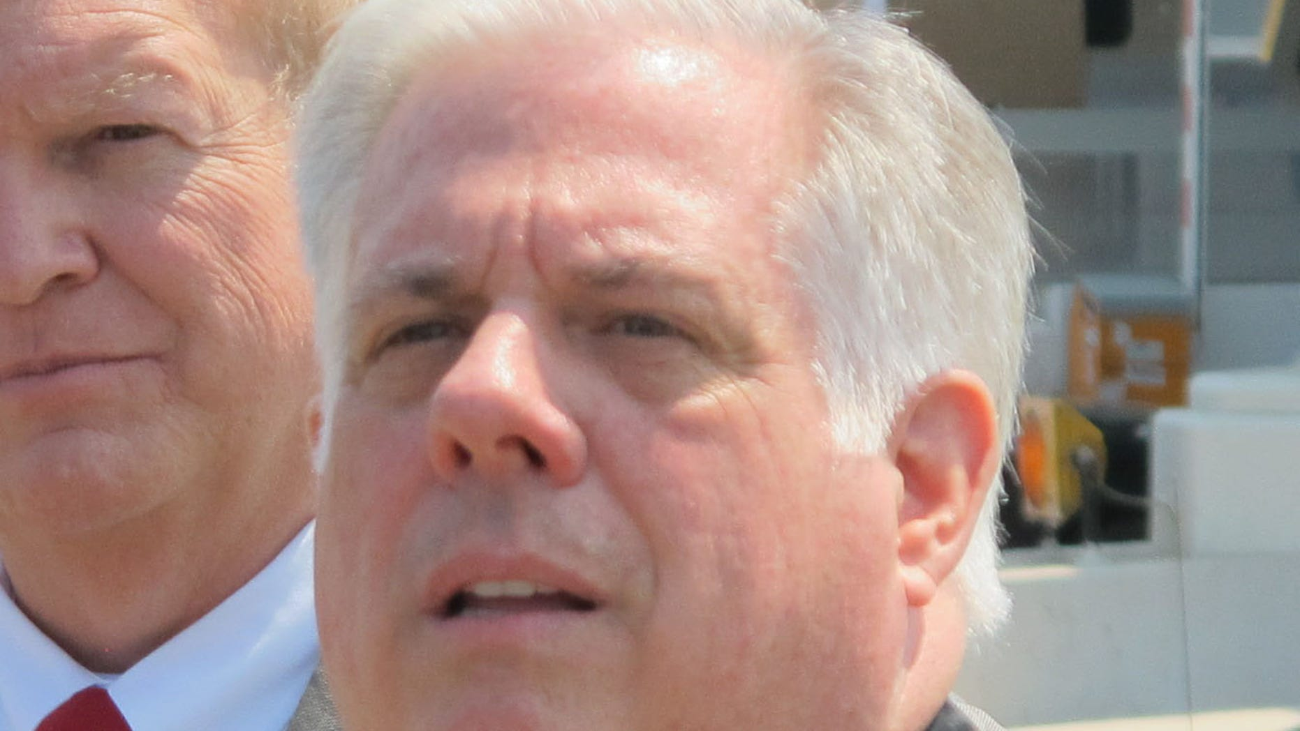 May 7, 2015: Maryland Gov. Larry Hogan, right, takes a question from a reporter.