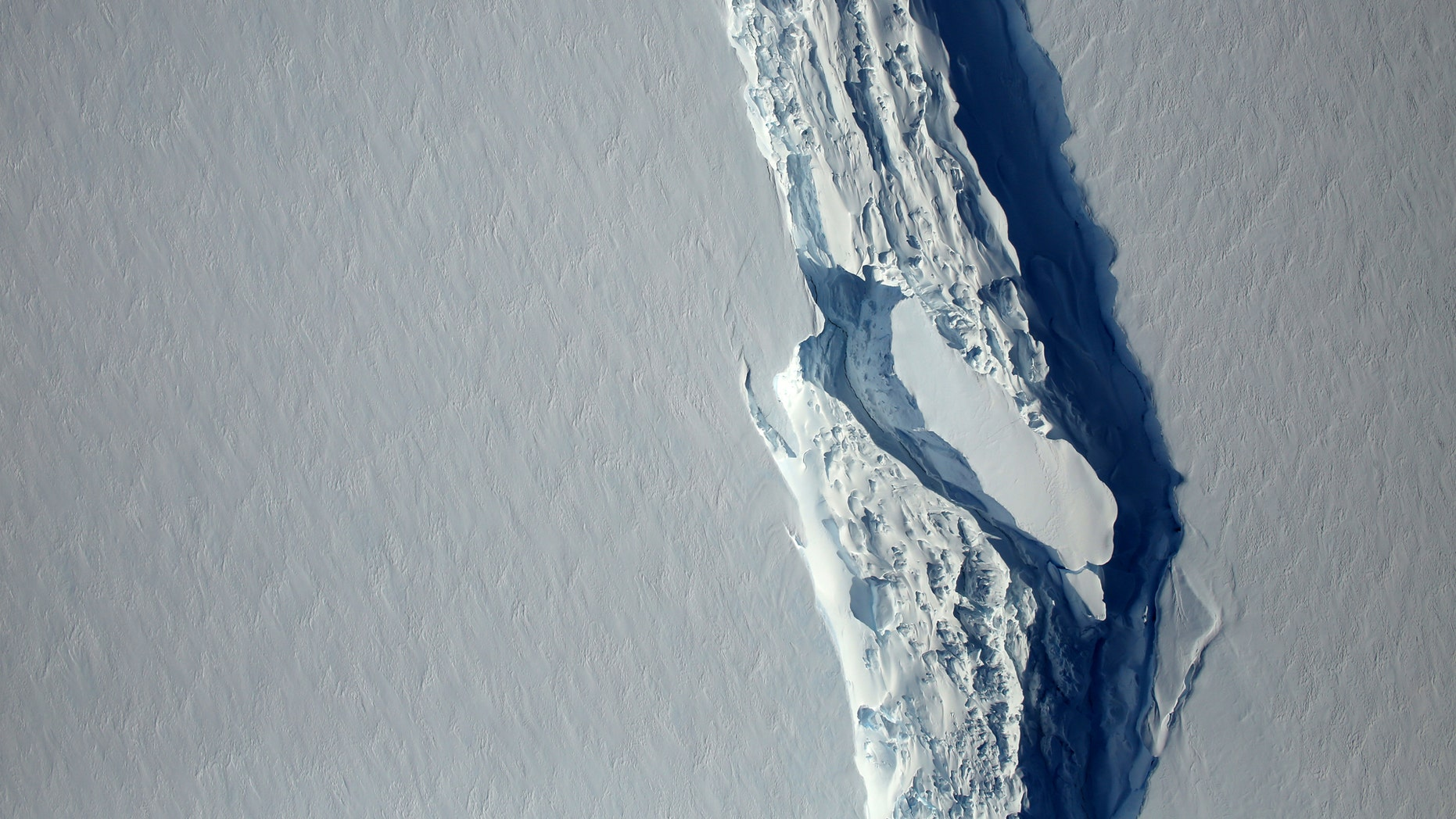 File photo - An aerial view of the rift in the Larsen C seen in an image from the Digital Mapping System over the Antarctica Peninsula, Antarctica, on November 10, 2016. (NASA's Goddard Space Flight Center/Handout via REUTERS)