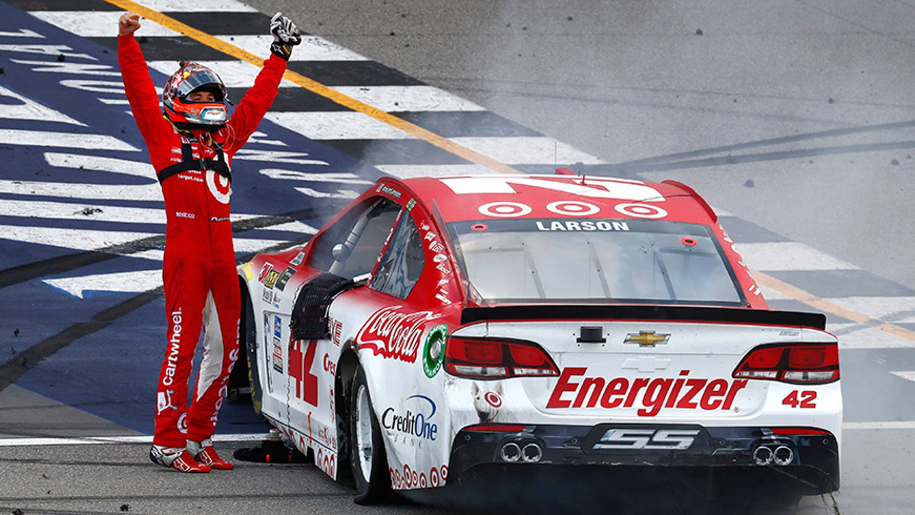 Kyle Larson celebrates winning a NASCAR Cup Series auto race in Brooklyn, Mich., Sunday, Aug. 13, 2017. (AP Photo/Paul Sancya)