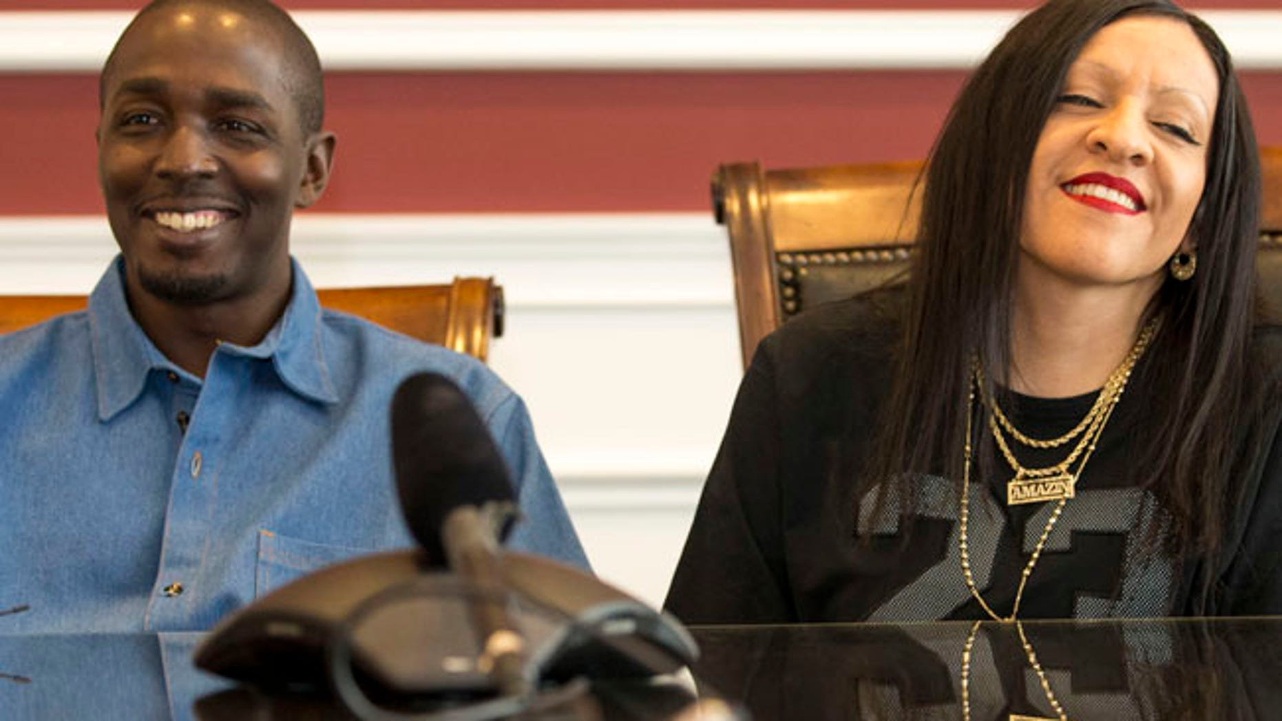 "DeMarlo Berry sits with his wife Odilia Berry during a news conference at the law office of Eglet Prince in Las Vegas on Friday, June 30, 2017. DeMarlo Berry was freed from prison after 23 years behind bars for a crime he didn't commit said Friday he felt ""a little overwhelmed"" by changes in the city where he was arrested when he was 19.  (Richard Brian/Las Vegas Review-Journal via AP)"