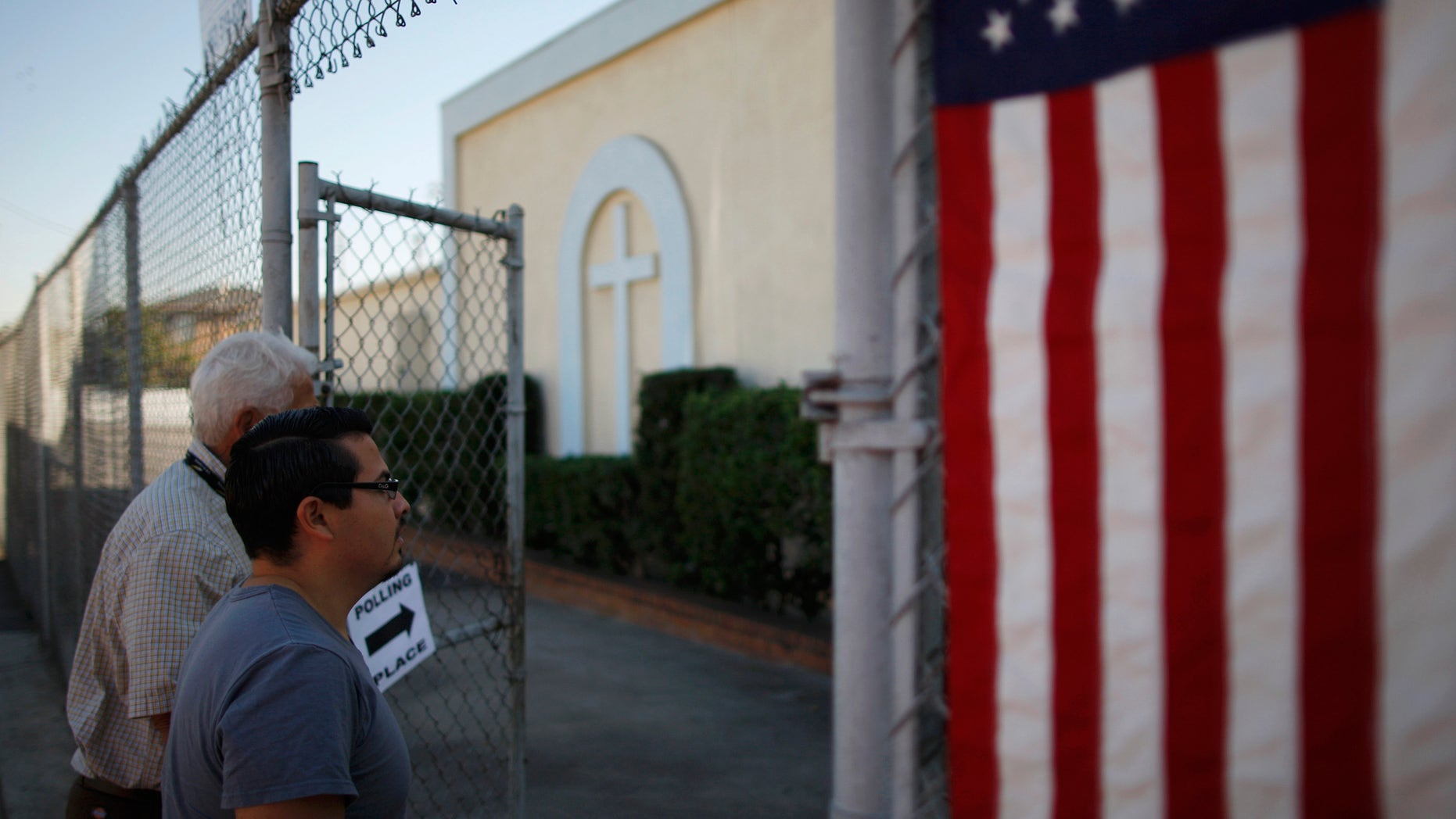 LOS ANGELES, CA - NOVEMBER 6:  People enter a polling place in the heavily Latino East L.A. area during the U.S. presidential election on November 6, 2012 in Los Angeles, California. The election will decide whether Democrat Barack Obama serves a second term as president of the United States or is replaced by Republican rival, former Massachusetts Gov. Mitt Romney.   (Photo by David McNew/Getty Images)