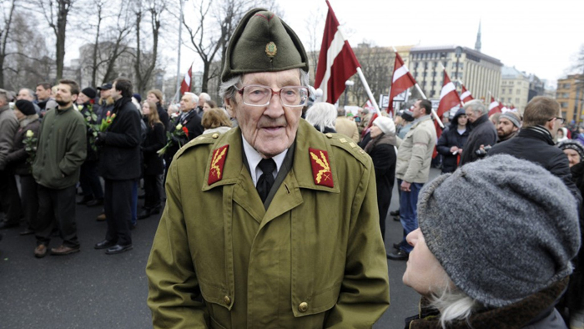 An elderly Latvian takes part in a ceremony to honor soldiers who fought in a Waffen SS unit during World War II, in Riga, Latvia, last year. (AP/Roman Koksarov)