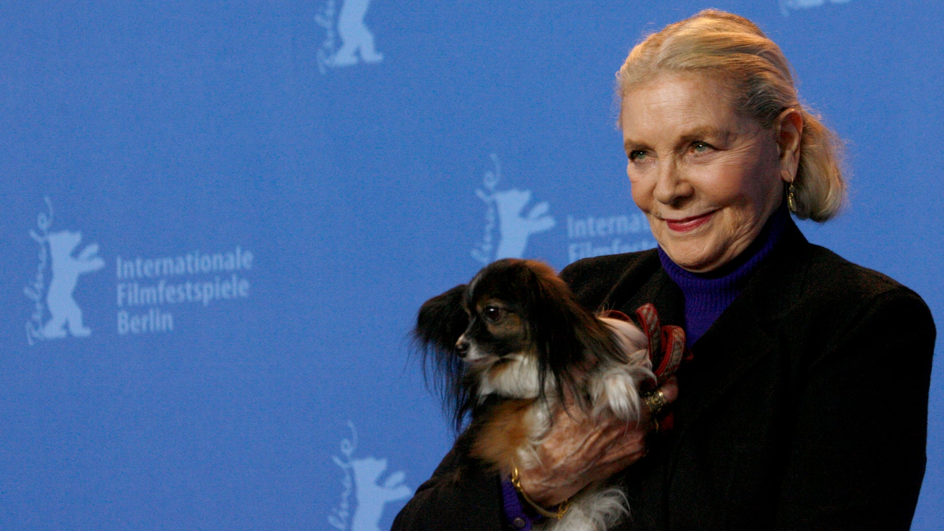 February 13, 2007. U.S actress Lauren Bacall poses with her dog Sophie at the 57th Berlinale International Film Festival in Berlin.