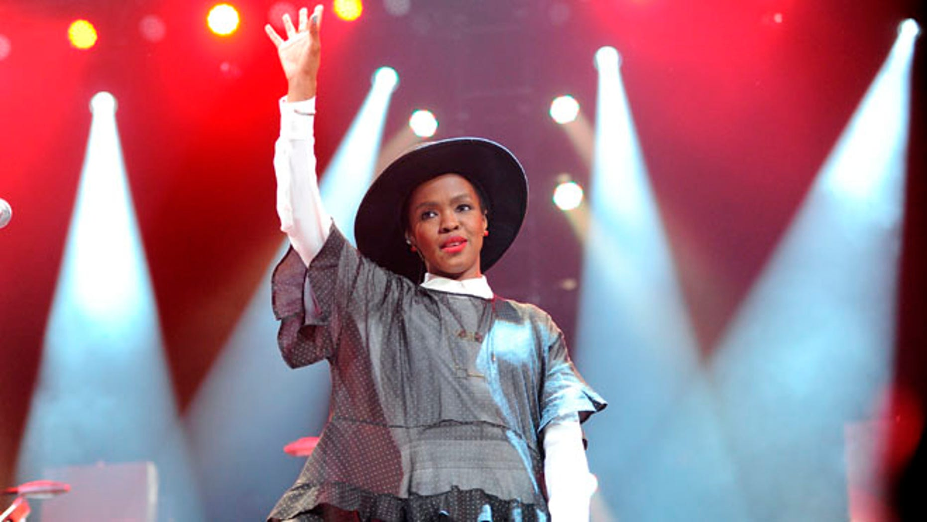 "Feb. 5, 2014 file photo, singer Lauryn Hill performs at Amnesty International's ""Bringing Human Rights Home"" Concert at the Barclays Center in New York."