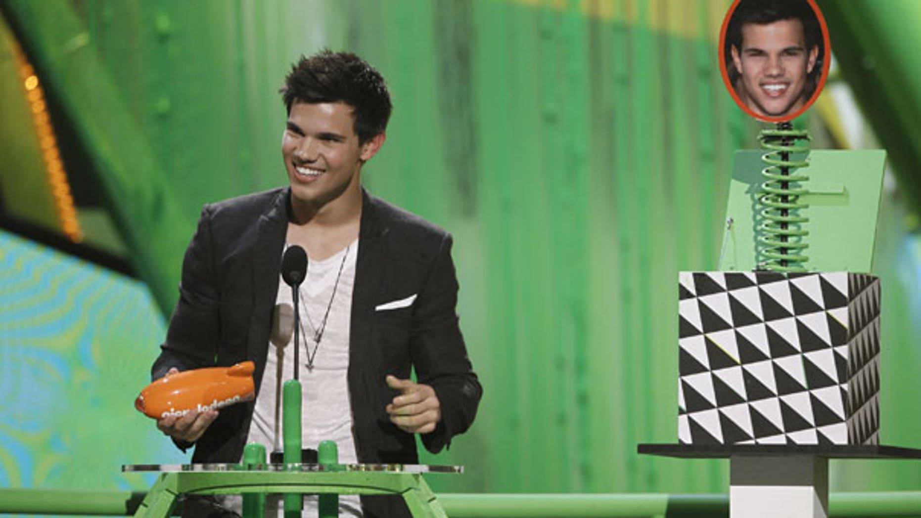March 27: Taylor Lautner accepts the award for favorite movie actor at Nickelodeon's 23rd Annual Kids' Choice Awards. (AP)