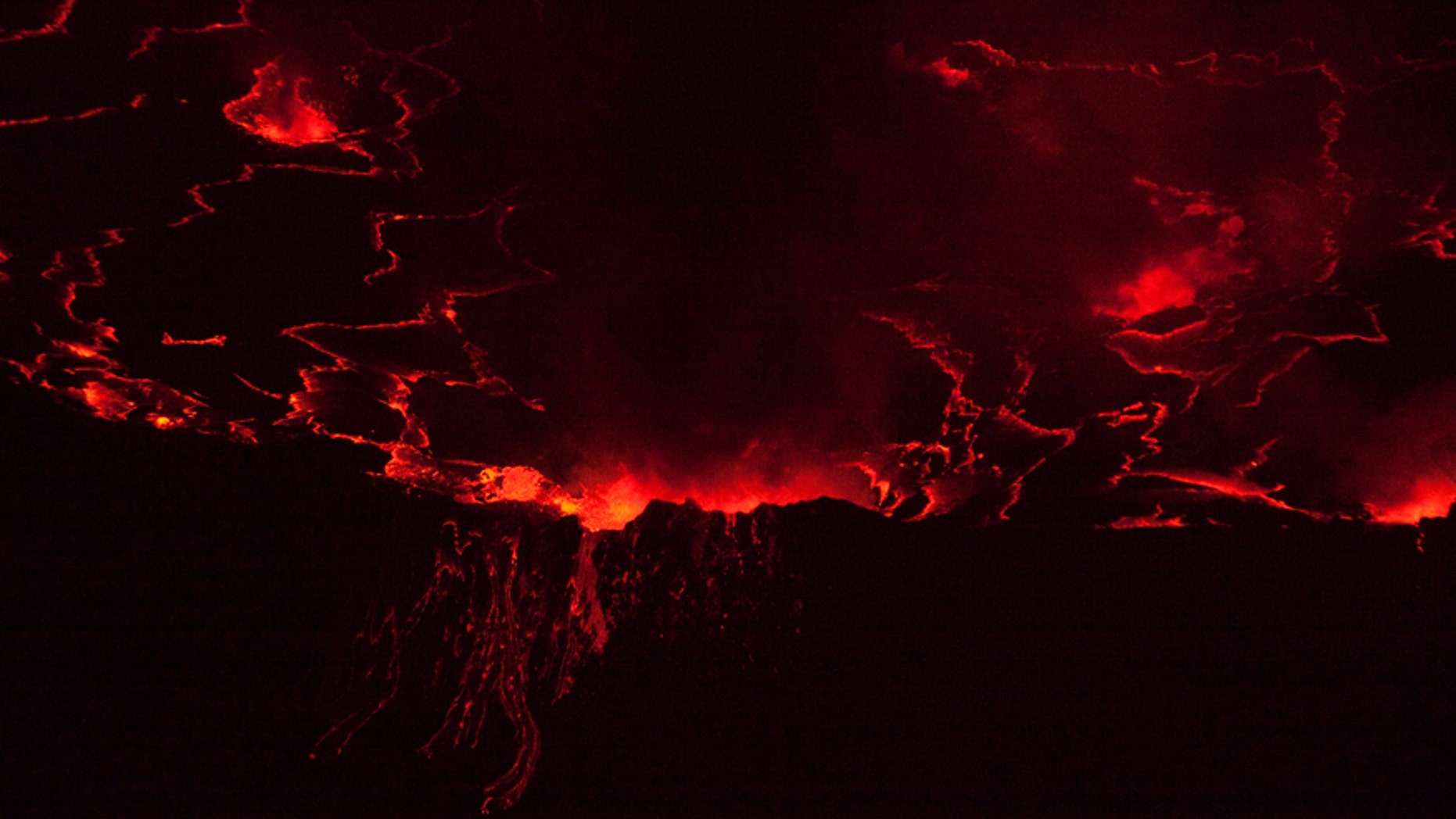 File photo - A lava lake with a diameter of 500 feet glows at night in the crater of Nyiragongo volcano near Goma in eastern Congo, Aug. 30, 2010. (REUTERS/Finbarr O'Reilly)