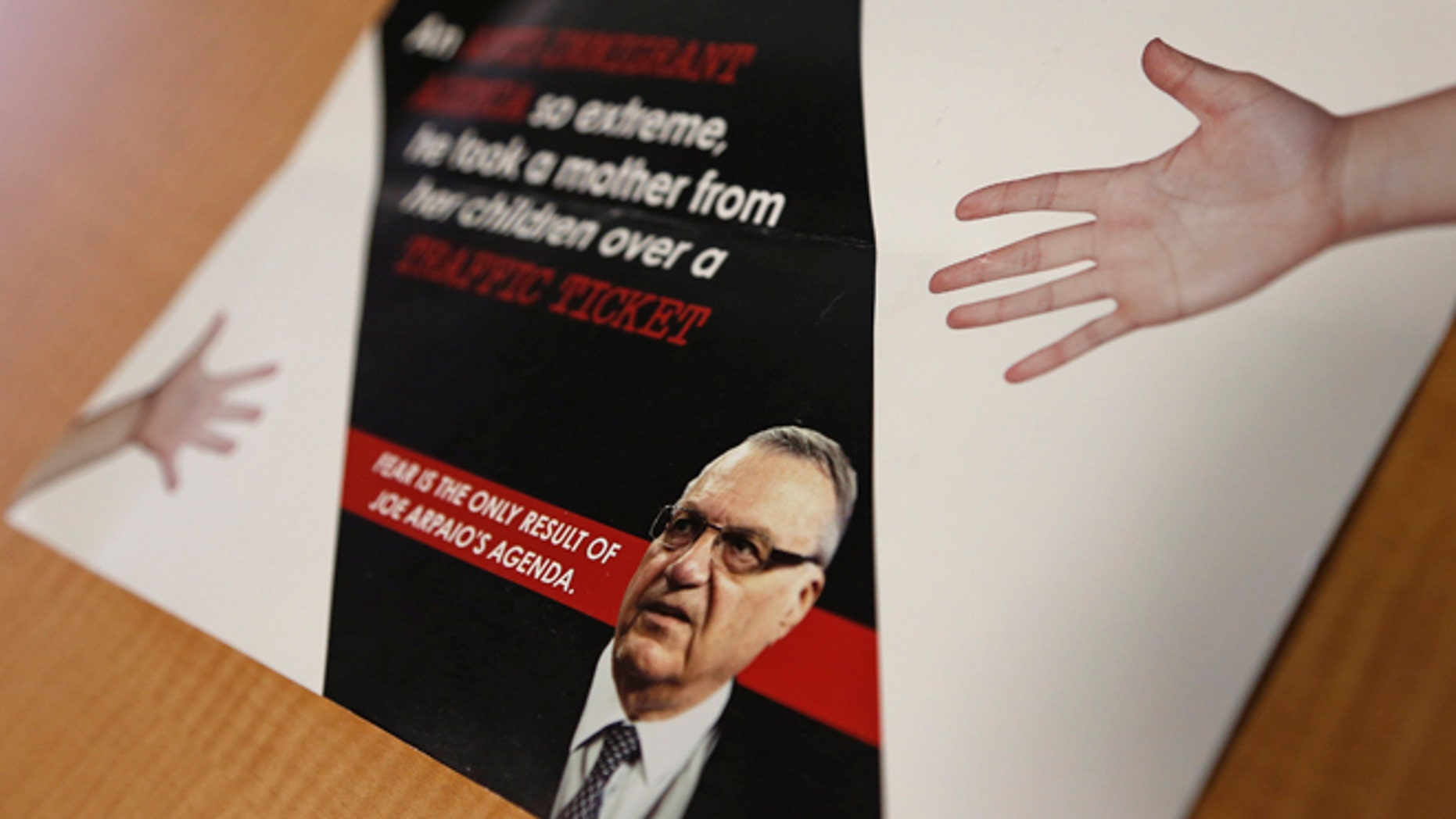 A group backed by the New York hedge fund billionaire George Soros, a longtime bankroller of liberal political causes, is mailing anti-Joe Arpaio fliers to Phoenix-area voters shown here, Tuesday, Sept. 13, 2016, in Phoenix.