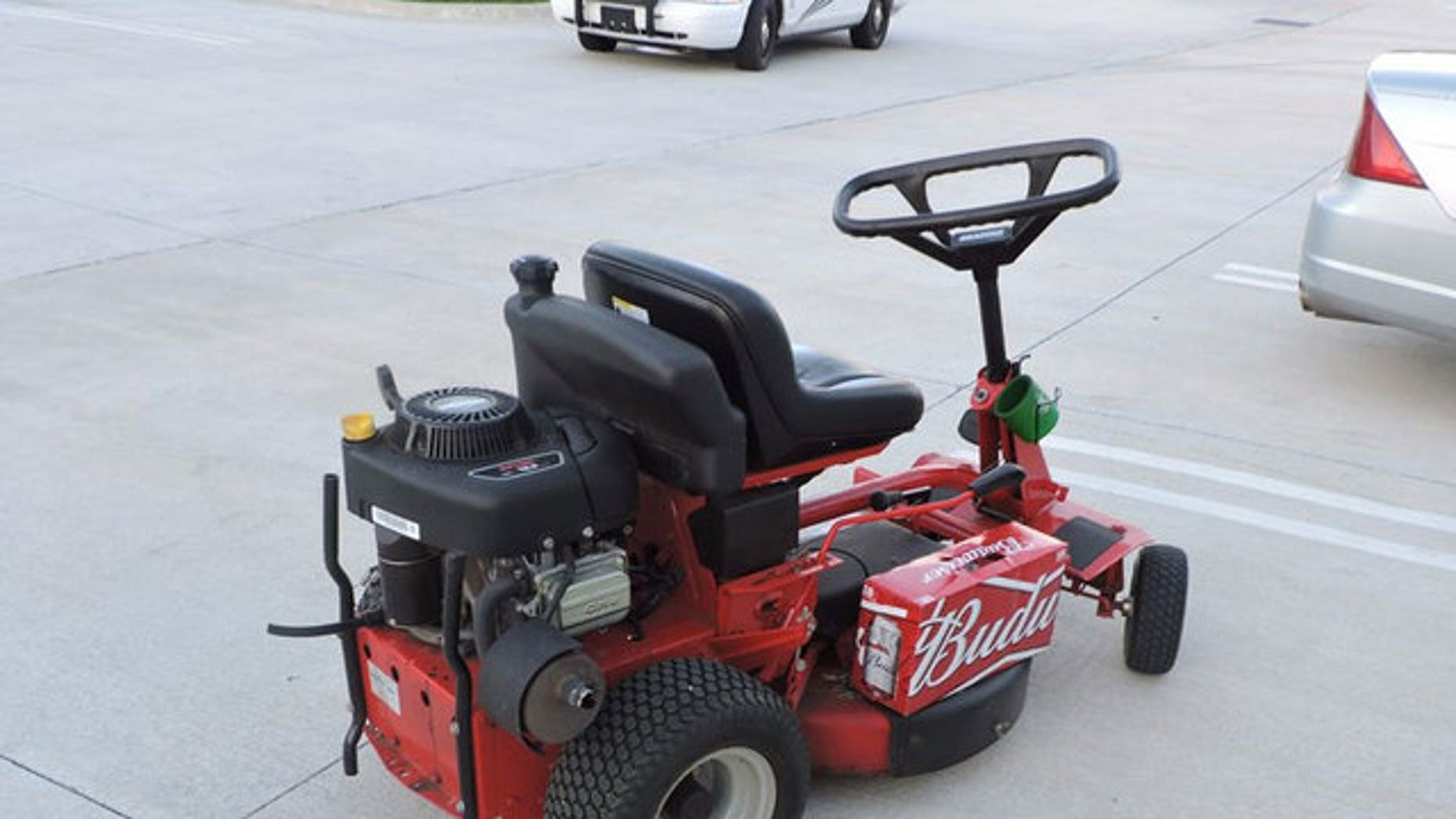 Police arrested a man in Florida after he drove down U.S. Highway 1 on a lawn mower, holding a case of beer.
