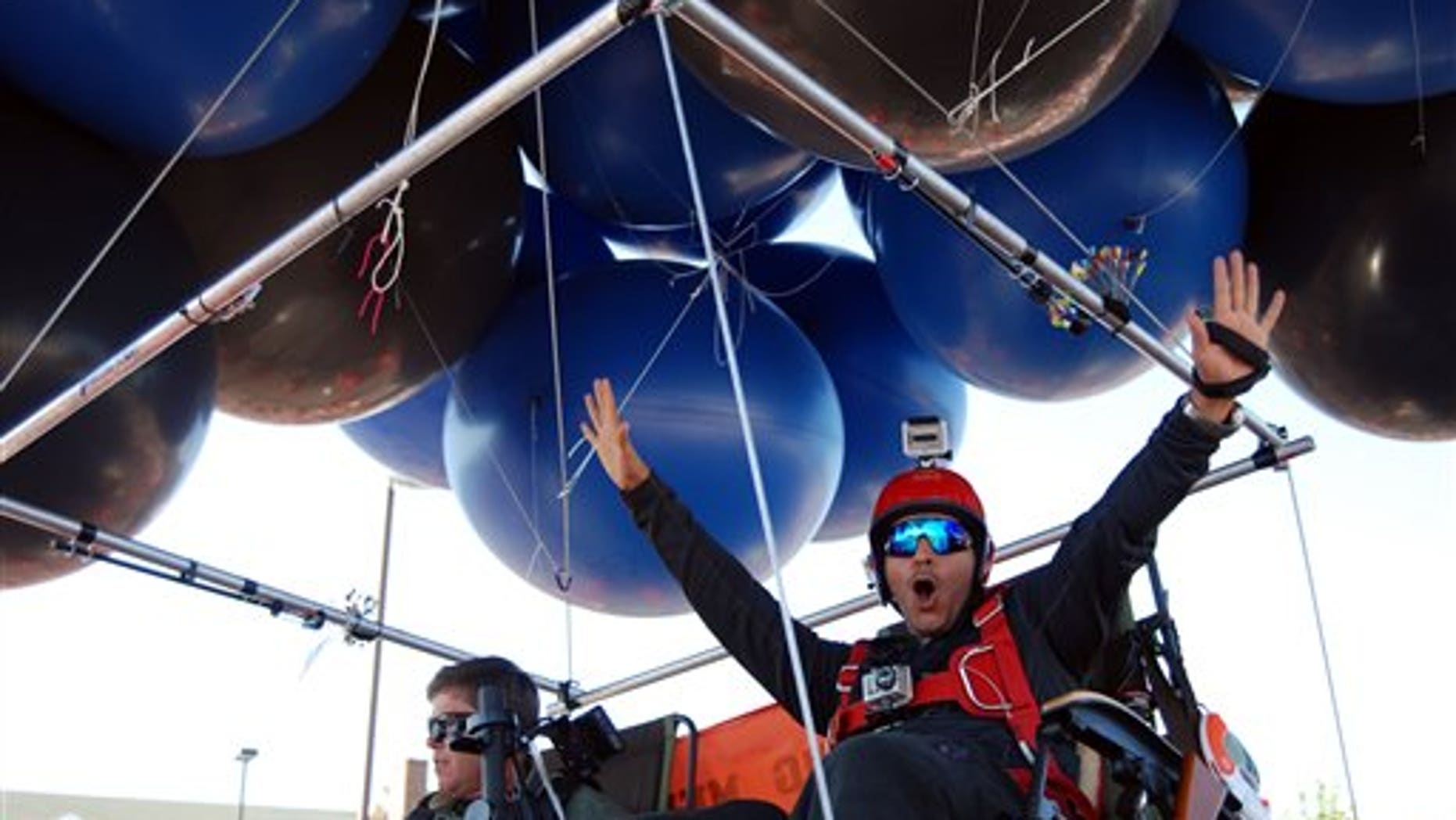 July 14, 2012: Iraqi adventurer Fareed Lafta, right, and Bend, Ore., gas station owner Kent Couch lift off from Couch's gas station in Bend, Ore., as they attempt to fly some 360 miles to Montana.