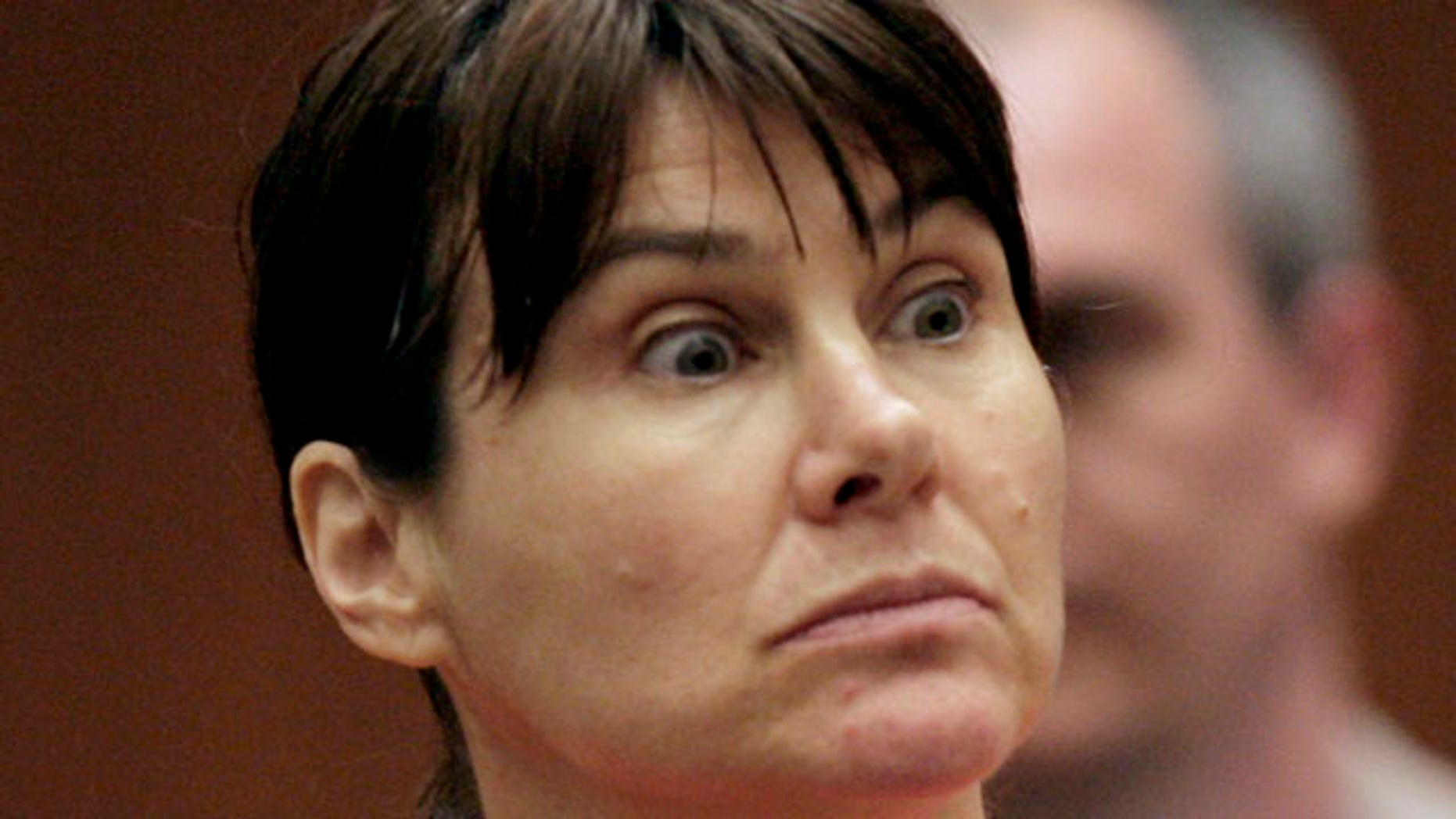July 29, 2009: Former Los Angeles police officer Stephanie Lazarus appears in court in Los Angeles. Lazarus is accused of killing an ex-boyfriend's wife 23 years ago when she was a young officer.