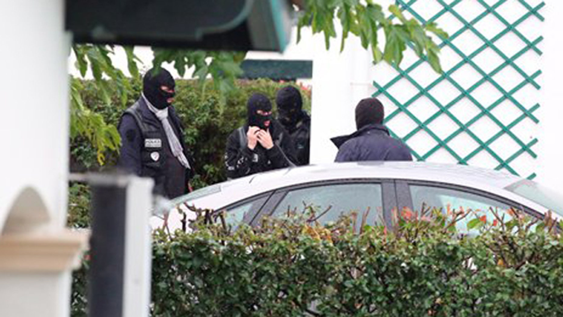 """French police officers outside a villa during a search operation in Ascain, south western France, Saturday, Nov. 5, 2016. French police arrested the leader of the debilitated Basque militant group ETA, Spain's Interior Ministry said Saturday. Spanish authorities identified Mikel Irastorza as """"currently the maximum leader"""" of ETA. (AP Photo)"""